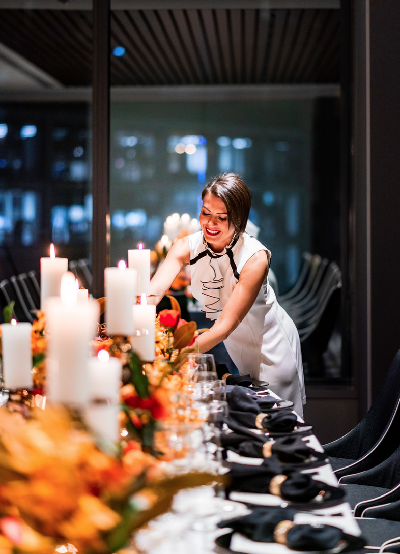 corporate_event_design_events_by_nadia_fresh_flowers_orange_inlighten_photography_black_charger_plate_cutlery_candle_stick_gold_napkin_ring_king_table_nadia.png