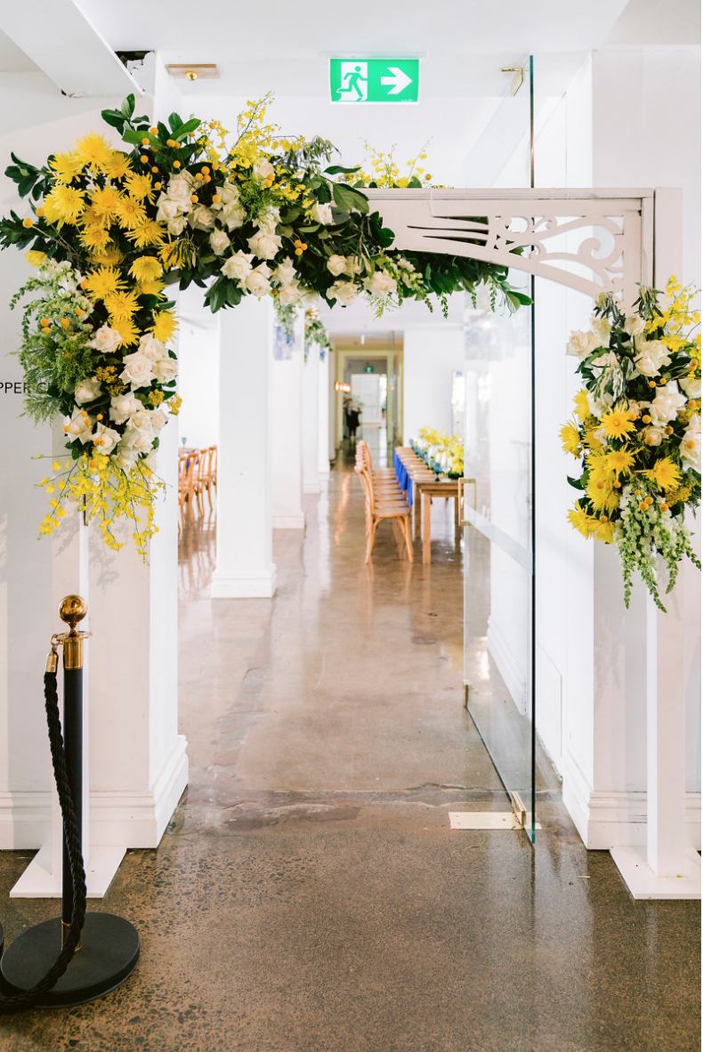 Special_event_activation_event_decor_event activation_positano_theme_archway_flowers_yellow_white_greenary .png
