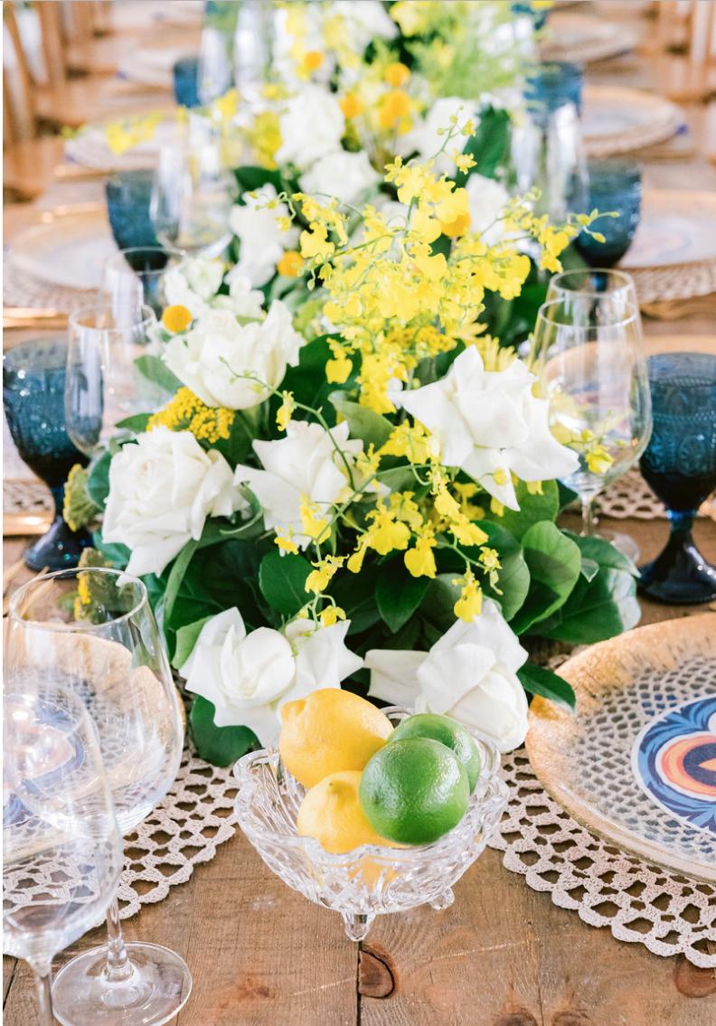Special_event_activation_event_decor_event activation_positano_theme_blue_glasswear_lemon_lime_white_flowers.png
