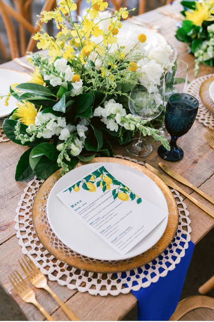 Special_event_activation_event_decor_event activation_positano_theme_menu_yellow_blue_gold_charger_plate_gold_cutlery.png