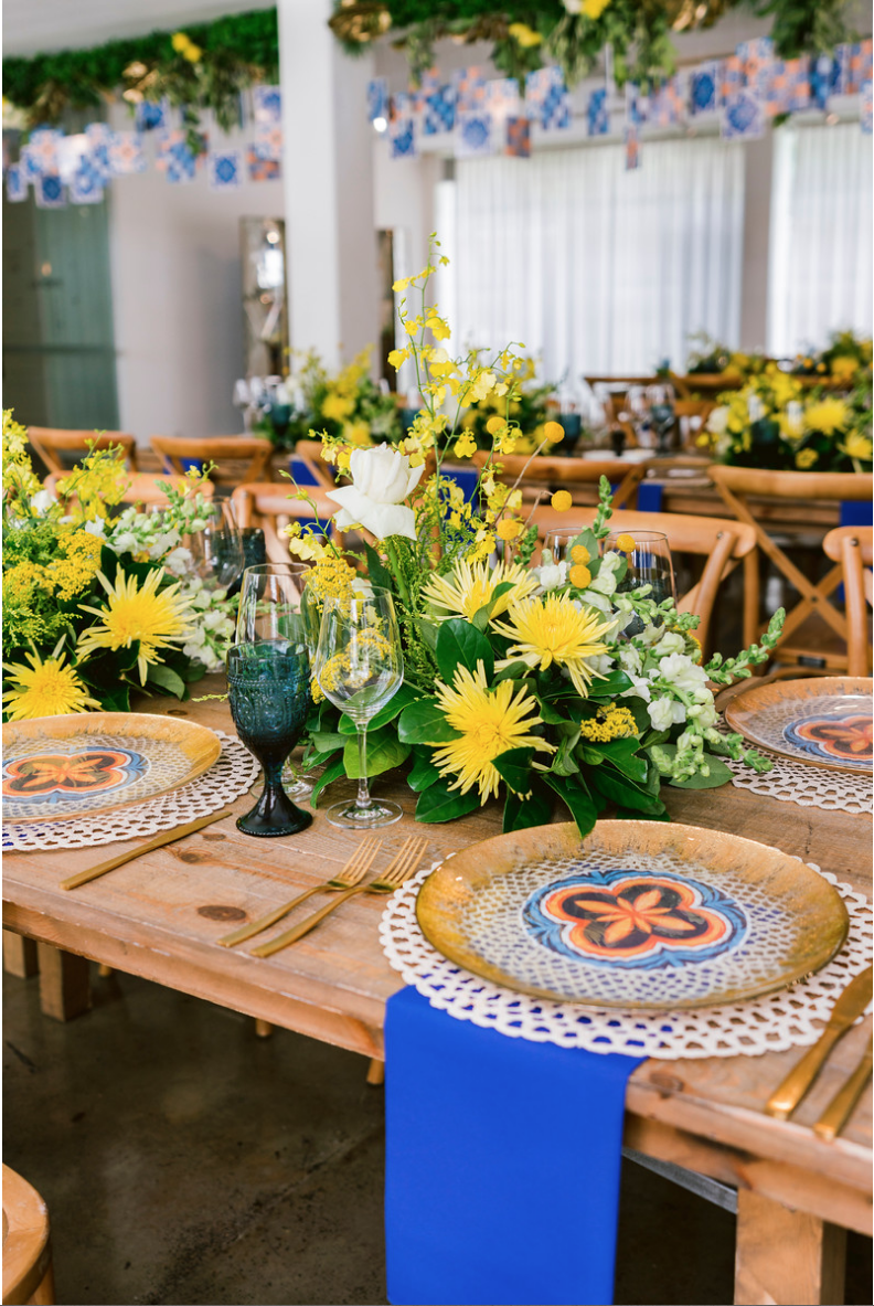 Special_event_activation_event_decor_event activation_positano_theme_menu_yellow_blue_gold_charger_plate_gold_cutlery_wood_table.png