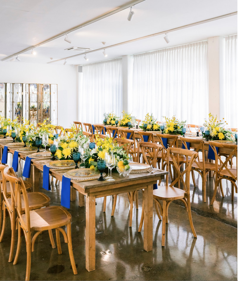 Special_event_activation_event_decor_event activation_positano_theme_menu_yellow_blue_napkin_wood_tables_wood_chairs.png