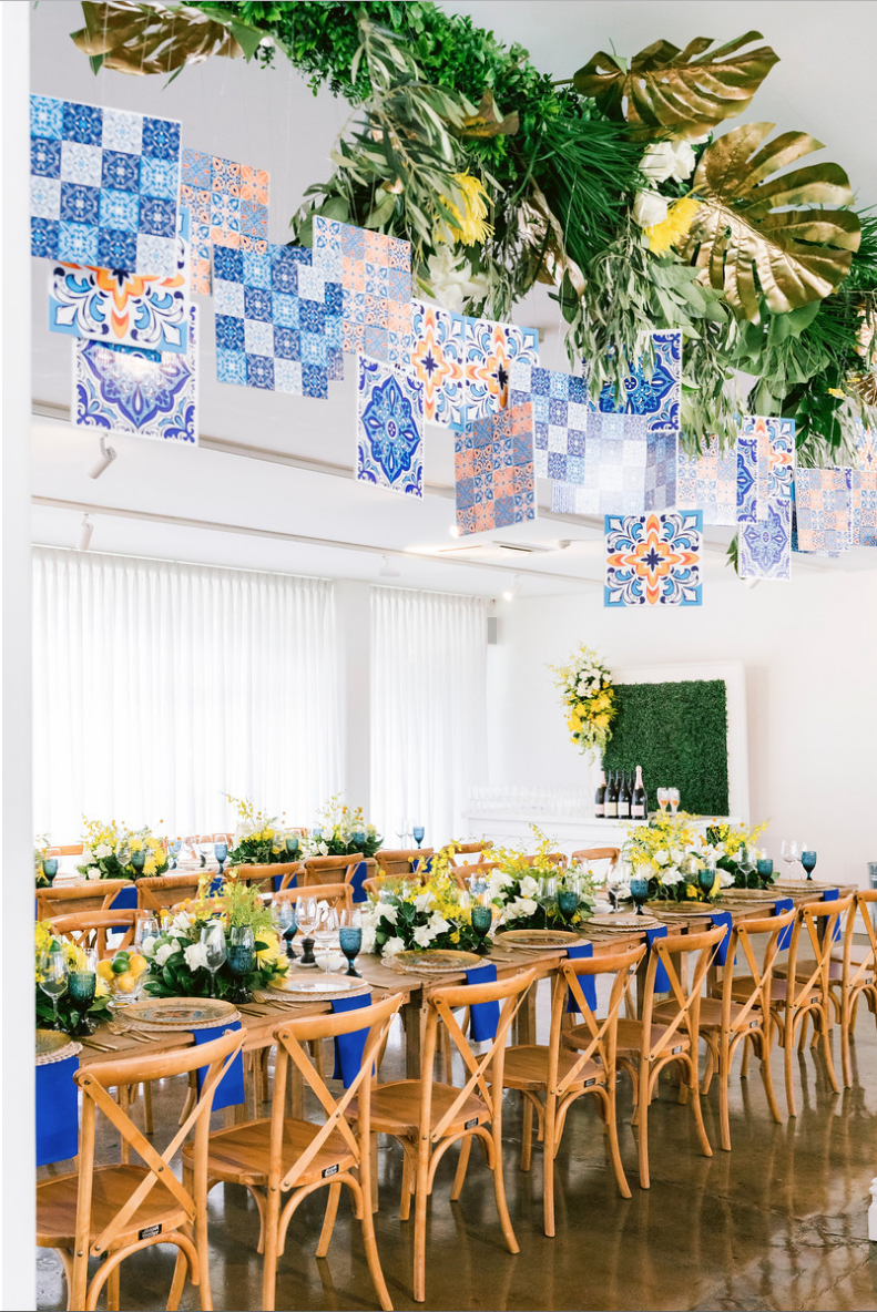 Special_event_activation_event_decor_event activation_positano_theme_setup_king_tables_hanging_tiles.png