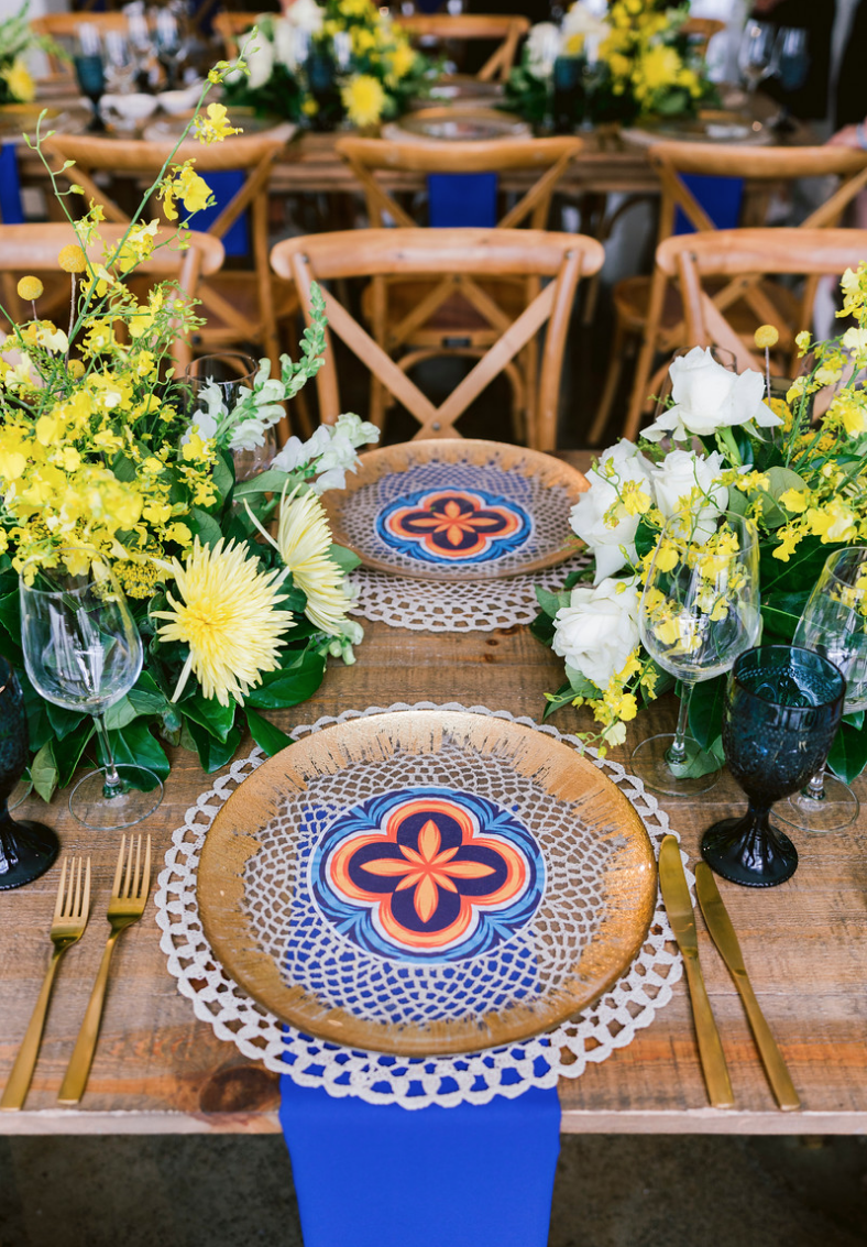 Special_event_activation_event_decor_event activation_positano_theme_tile_gold_charger_plates_blue_napkin_gold_cutlery_yellow_flowers.png