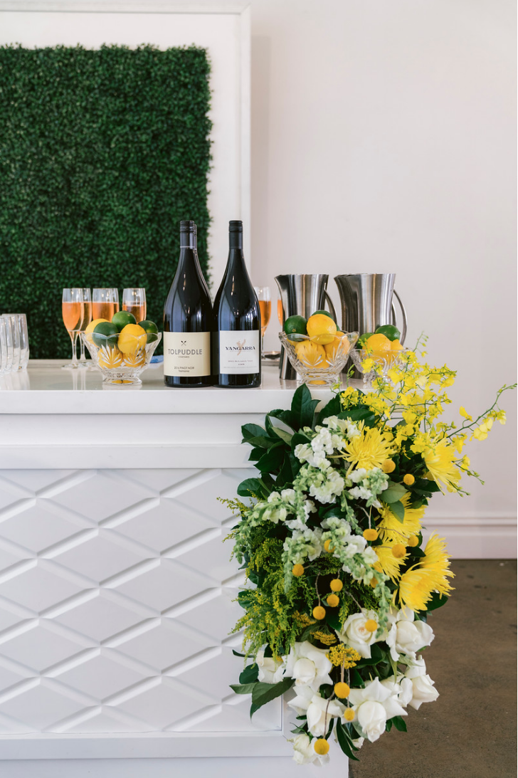 Special_event_activation_event_decor_event activation_positano_theme_yellow_white_flowers_bar_wine.png