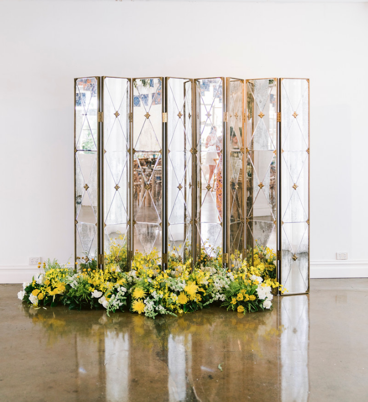 Special_event_activation_event_decor_event activation_positano_theme_yellow_white_flowers_gold_backdrop.png