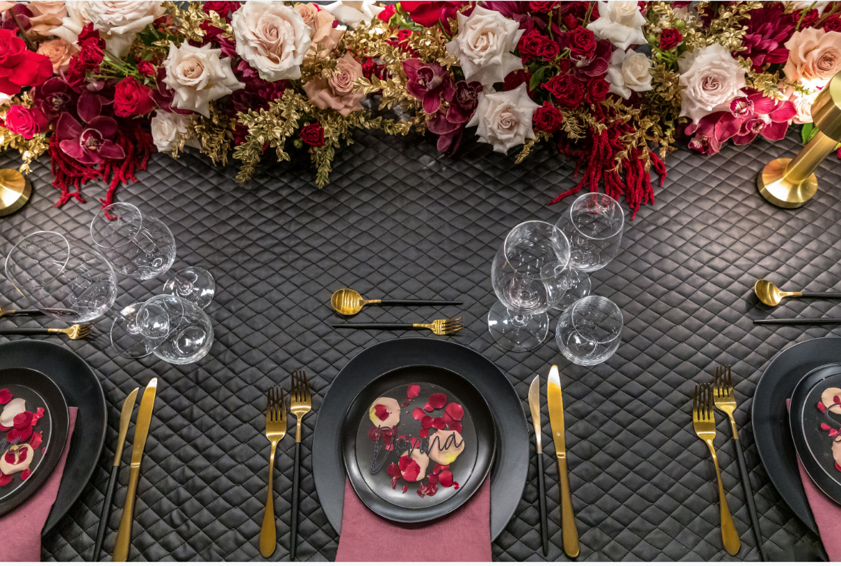 Hire_black_channel_luxury_linen_event_decor_sydney_wedding_gold_cutlery_red_flowers_cream_roses.png