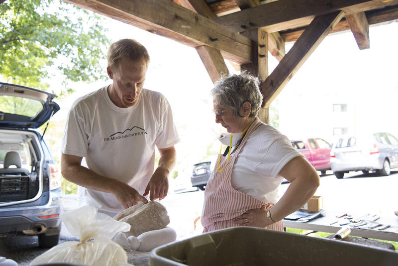 """August 7, 2015 - The Augusta Heritage Centeris known around the world for its many music workshops and jam sessions. But Augusta actually started as a way to keep traditional arts and crafts alive in Randolph County.""""Well, it's gonna be a rabbit in the end,"""" Dorothy Steinbrueck said as she was chiseling away on a piece of alabaster stone under a hillside pavilion on the Davis & Elkins College campus earlier this week. She was surrounded by rock chips as she concentrated on the task at hand...CREDIT JESSE WRIGHT / WEST VIRGINIA PUBLIC BROADCASTINGRead or listento the full story (4:41 min)"""
