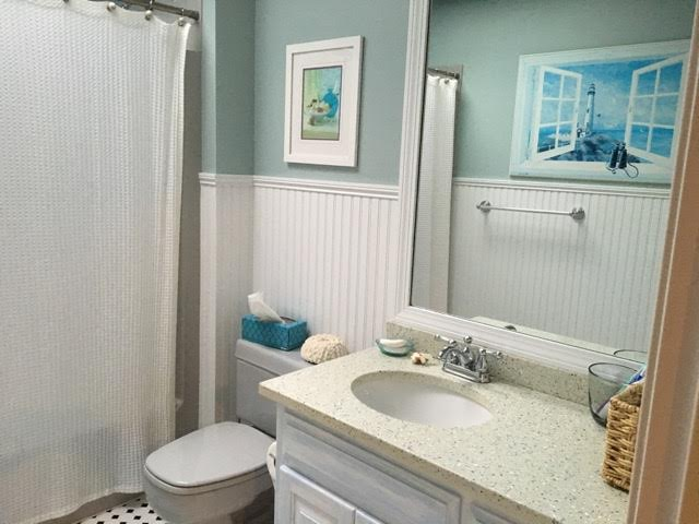 Updated bathroom with unique wainscoting