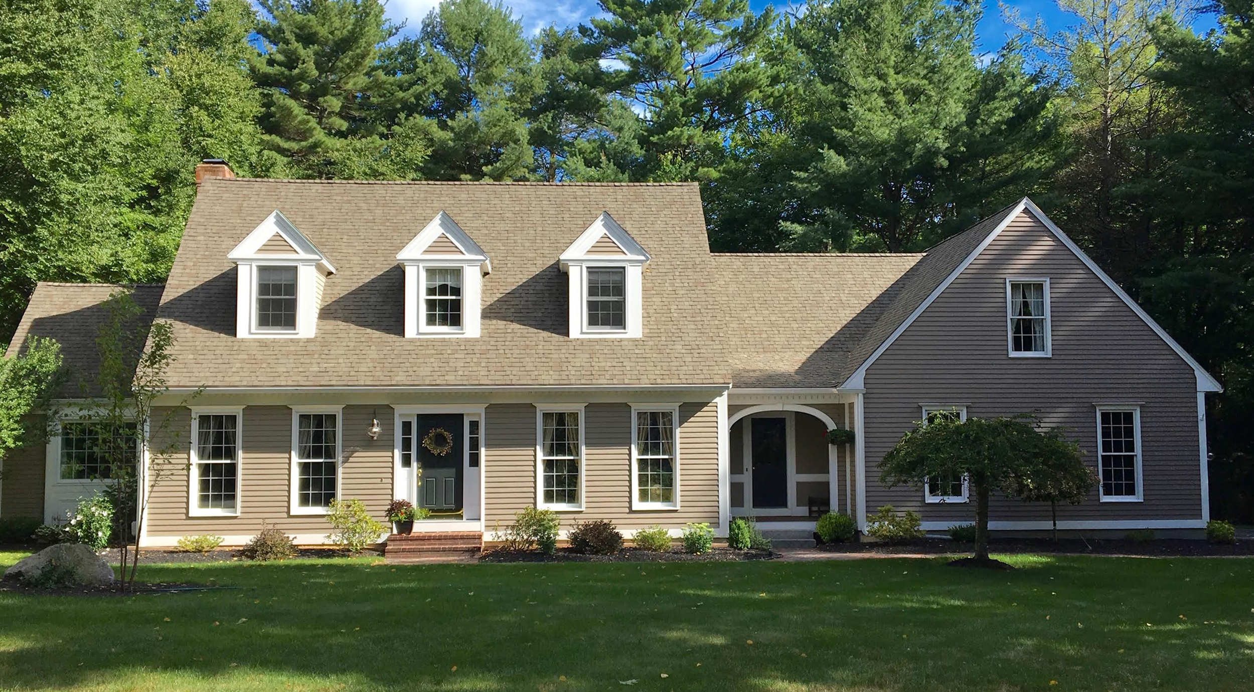 Classic New England cape with dormers and fresh paint