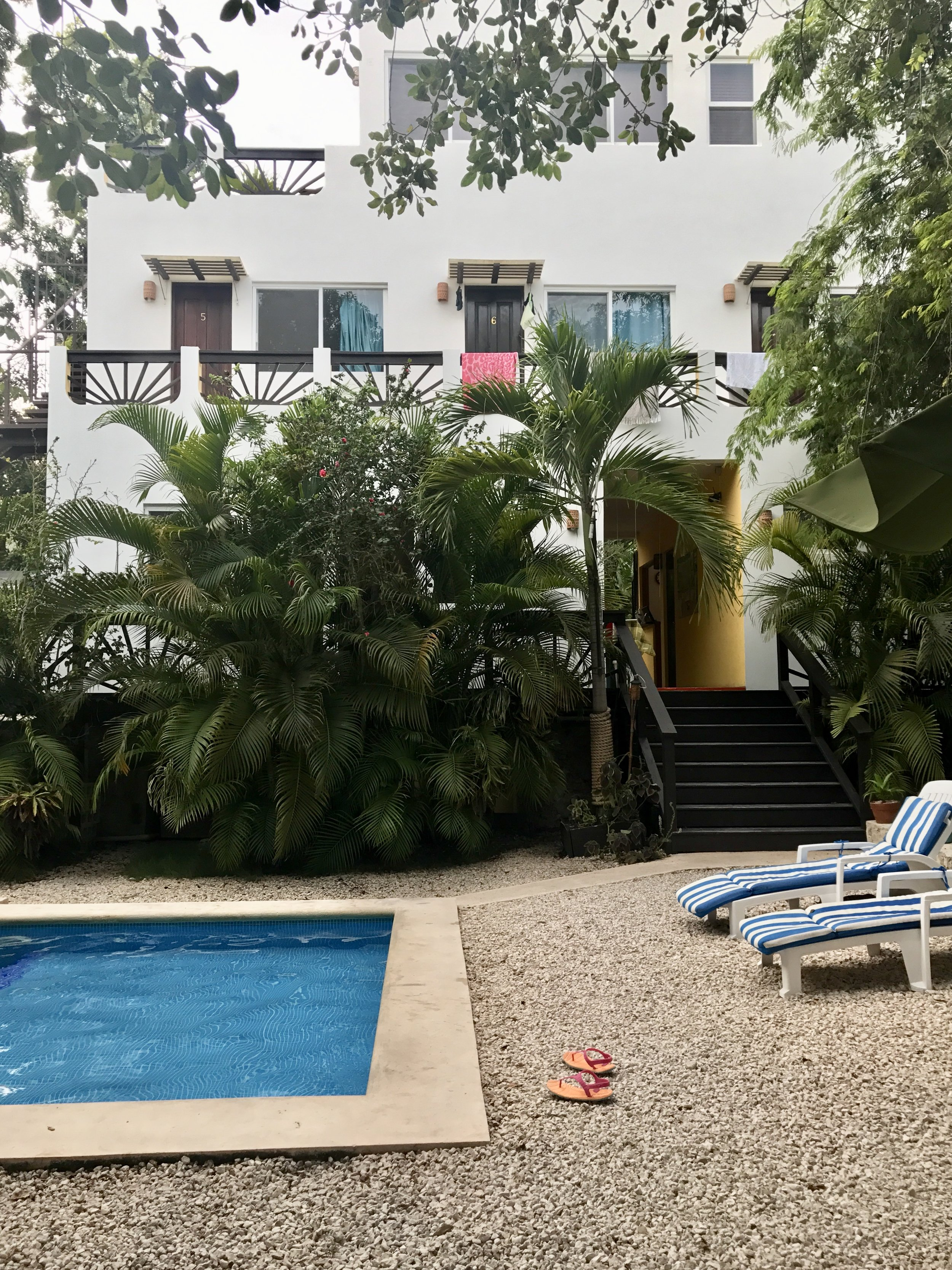 Back garden and pool at Mango Tulum