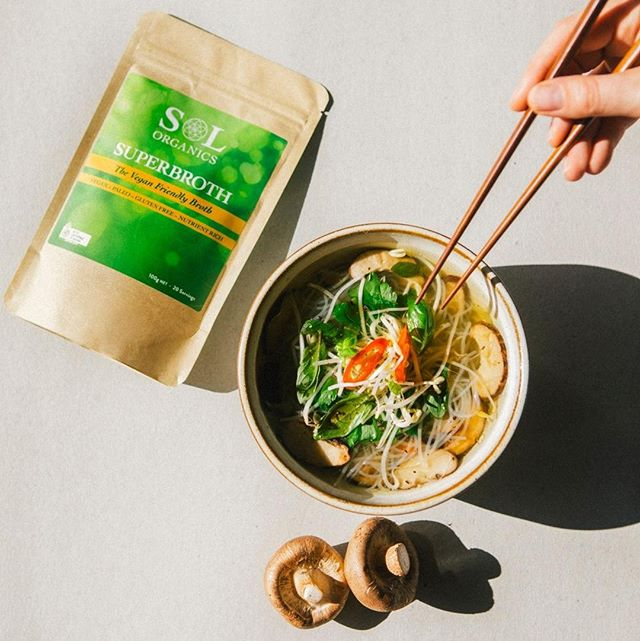 You know what we know  P H O  sure?  That our vegan friendly,  S U P E R B R O T H  is an incredible base for all your favourite soups, dressings, sauces & better still, in a spicy bowl of homemade Pho!  Not only is our vegan broth packed with nutrients, but it's bursting with flavour, making it easy to spice up with just a few simple ingredients, in a handful of minutes.  As a low carb menu choice, our vegan broth is  K E T O  friendly and full of gut healing ingredients like tumeric, parsley, garlic, shiitake, wakame, ginger and mustard seed. With it's anti inflammatory properties and immune boosting magic, you can kiss the keto flu good-bye!  Check out this super simple, hot Pho that we whipped up with a few fresh ingredients and just twenty minutes of time, to start warming up with the benefits of broth!  Sol Ghee Superbroth Shiitake Pho - serves 4  5 heaping TBSP of Sol Ghee Super Broth powder 8 cups filtered water 6 green onion - sliced 1 TBSP peeled, grated ginger  1 tsp Sol Ghee Coconut Oil blend ** for vegan version simply use coconut oil  1 cup shiitake mushrooms, stems removed and sliced 1 1/2 TBSP hoisin sauce  1 TBSP Braggs Amino Acids ** for non GF/vegan option use soy sauce  2 tsp sesame oil  1/2 package vermicelli rice noodles  2 cups of bean sprouts  1 whole red chilli - sliced salt & pepper to taste Garnish with : basil, parsley, cilantro or fresh herbs of your choice & a lime wedge  1. Bring the filtered water and Superbroth powder to a boil, whisking until smooth  2. Add in 3/4 the sliced green onion, ginger, Bragg's Amino acids, 1 tsp sesame oil & 1 tsp hoisin sauce, stir and reduce to a simmer for 10-12 minutes  3. While the broth is boiling, add 1 tsp of Sol Ghee Coconut Oil blend to a pan at medium low heat and sauté until tender  4. Once broth has simmered, add in rice noodles for 2 minutes until cooked thru  5. Divide broth and noodles into serving bowls  Add in mushrooms, bean sprouts, salt & pepper  Garnish with your favourite herbs, fresh chilli slices and a slice of lime & ENJOY!  #broth #vegan #ketofriendly #ketolifestyle #ghee #ayurveda #keto #veganbroth #ayurvediclifestyle #healthylifestyle #healthyliving #pho #homemade