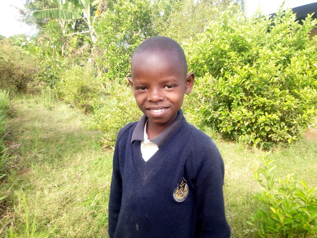 Shujaa - Jambo! Jambo! My name is Shujaa, I am 10 years old. I like eating pasta with beans. I enjoy doing Yoga. What makes me happy is studying and watching gardens. I don't enjoy being lazy. When I grow up I would like to become a teacher.