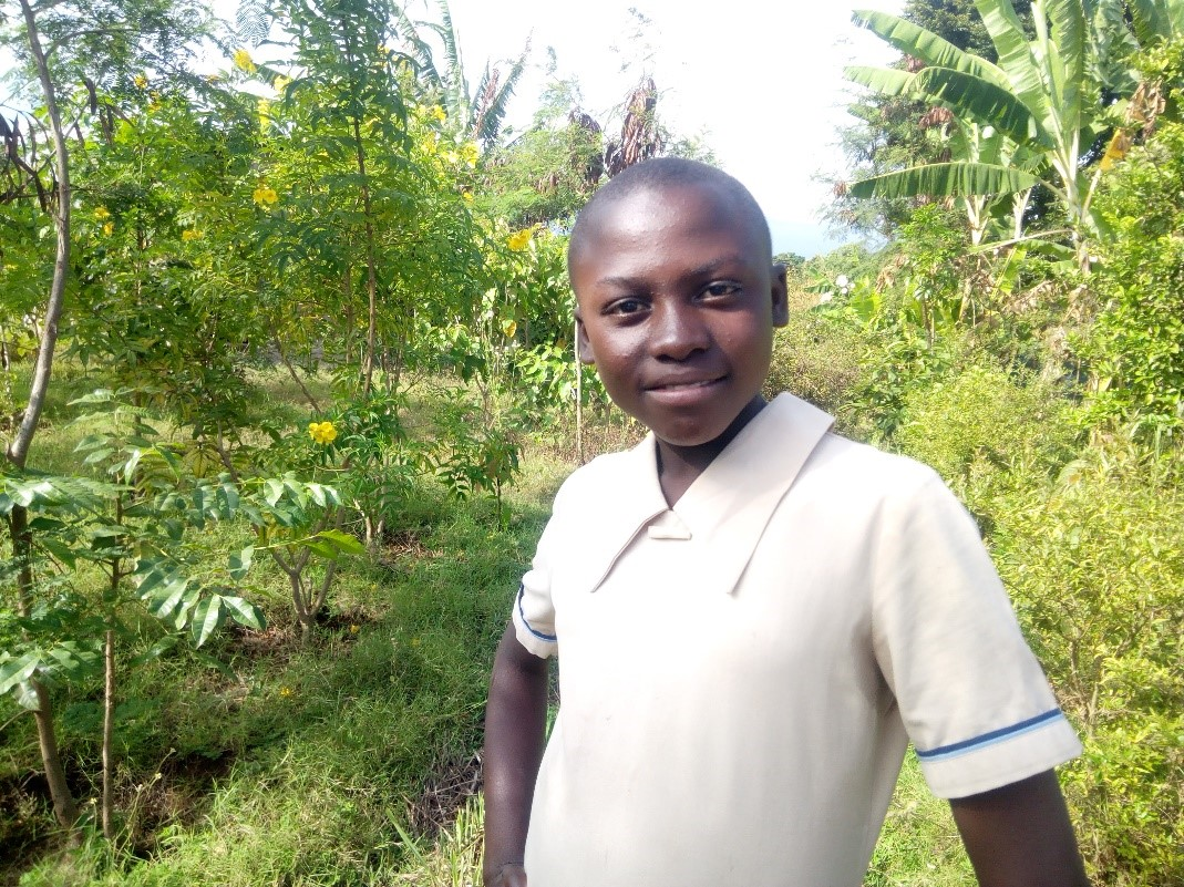 Asha - Jambo! Jambo! My name is Asha, I am 11 years old. I like eating rice. I enjoy when we do Yoga. What makes me happy is helping mamas in kitchen. I don't enjoy quarrel with my friends. When I grow up I would like to become a Doctor.