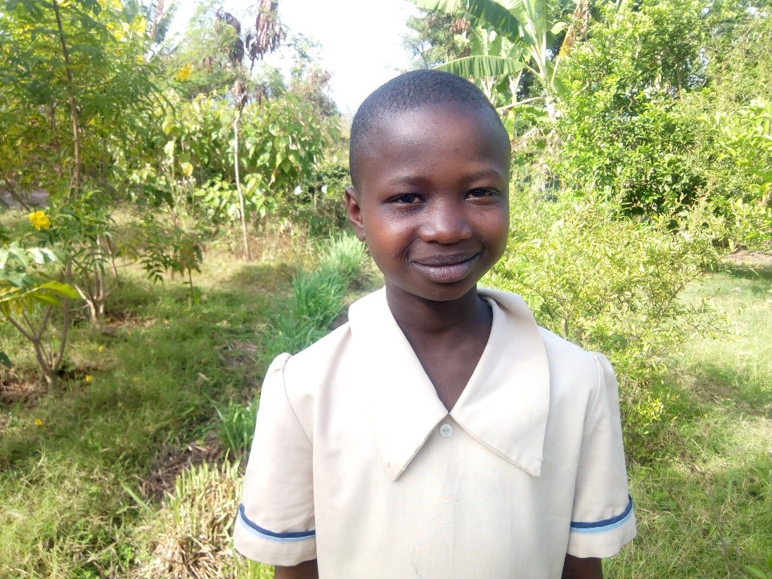 Violeth - Jambo! Jambo! My name is Violeth, I am 11 years old. I like eating rice with beef. I enjoy helping mama in kitchen. What makes me happy is when I get new things. I don't enjoy when I lose my properties. When I grow up I would like to become a teacher.