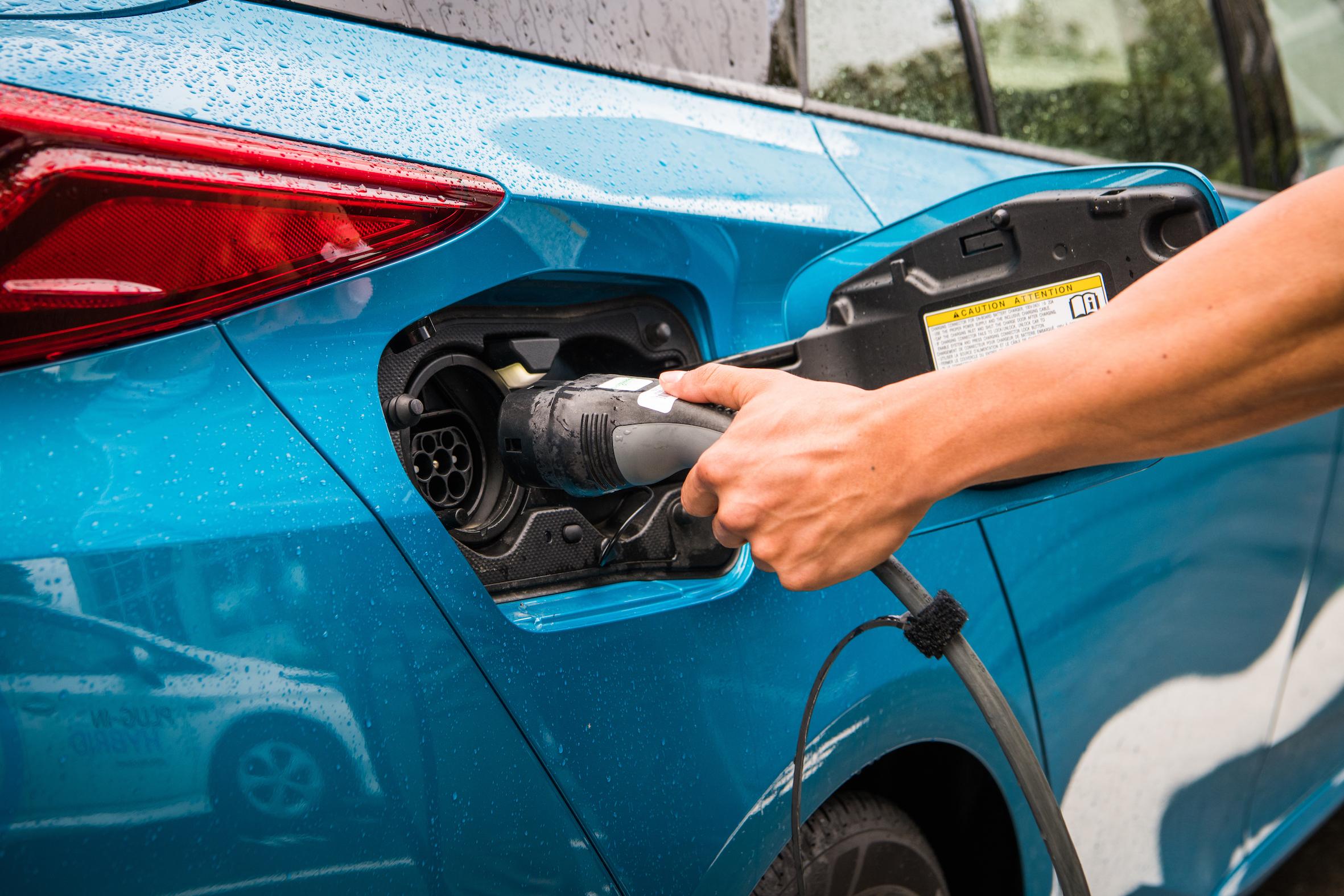 2018 Toyota Prius Prime, Blue magnetism, charging shot.jpg