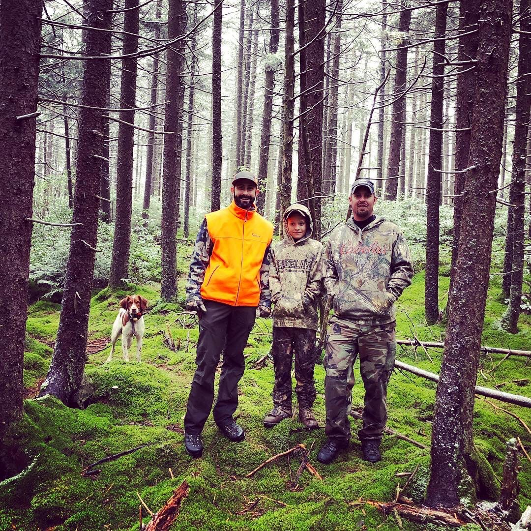 Justin, Easton, and Bradley in a moss/fern forest in West Virginia