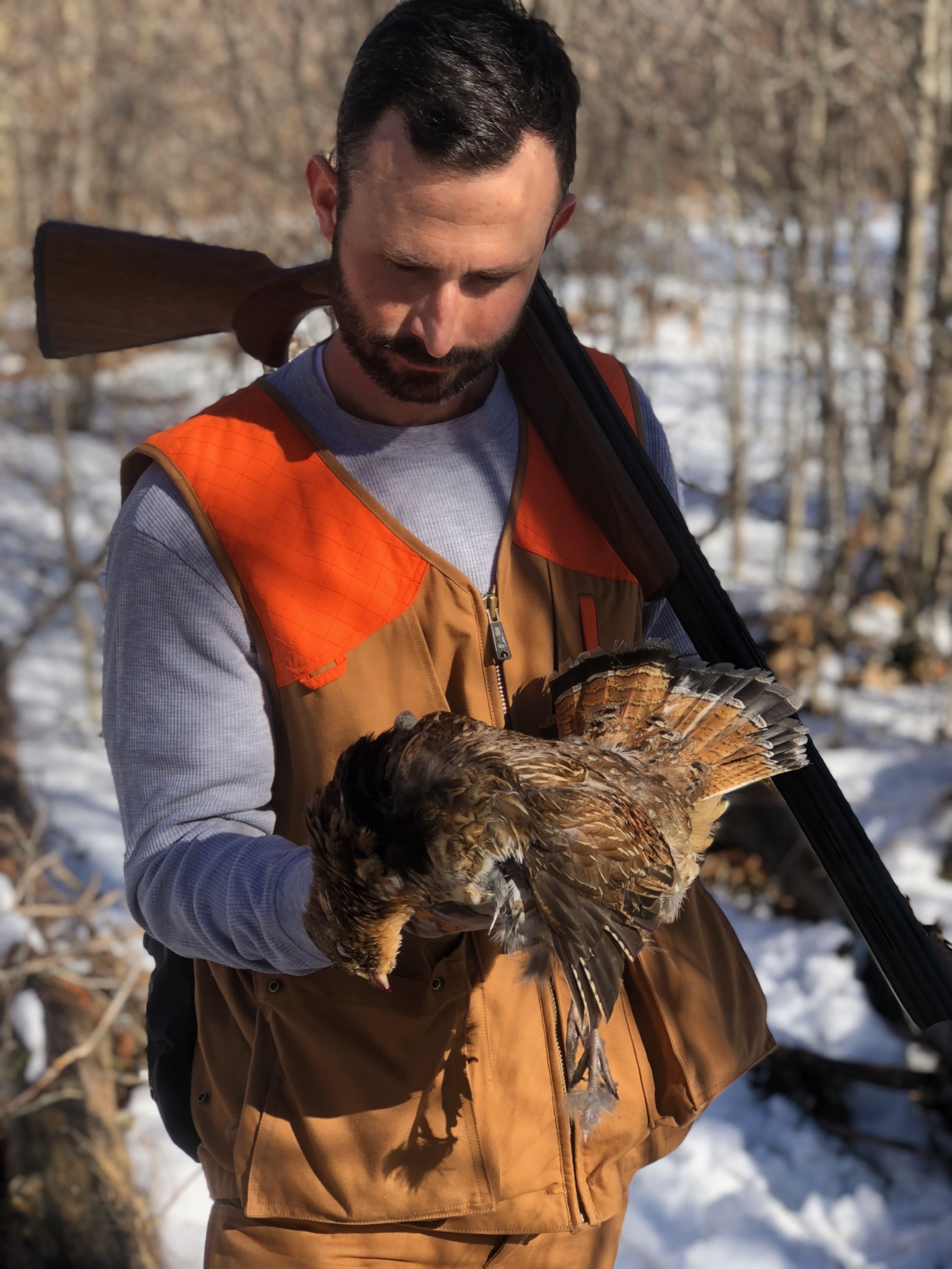 Justin with first Ruffed Grouse harvested over a pointing dog (photo credit: Cort Grubb)