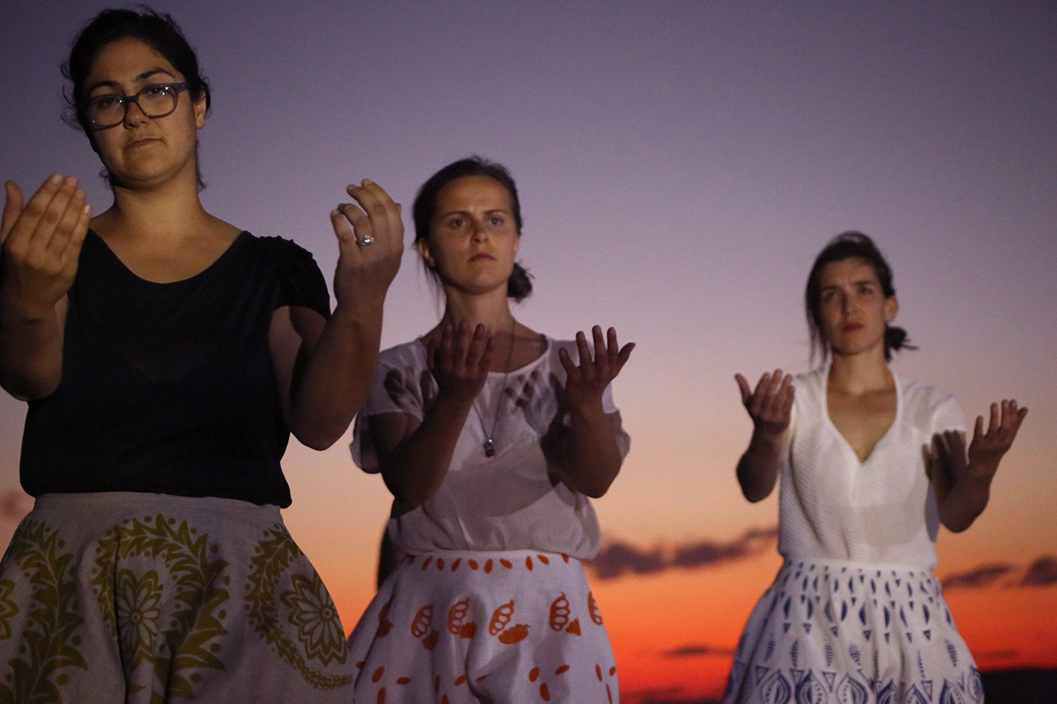 Anna Flouris (cultural Custodian), Miriam Pickard and Sia Cox perform in Craig San Roque's Persephone's Dog at the Old Ilparpa Quarry, Alice Springs.