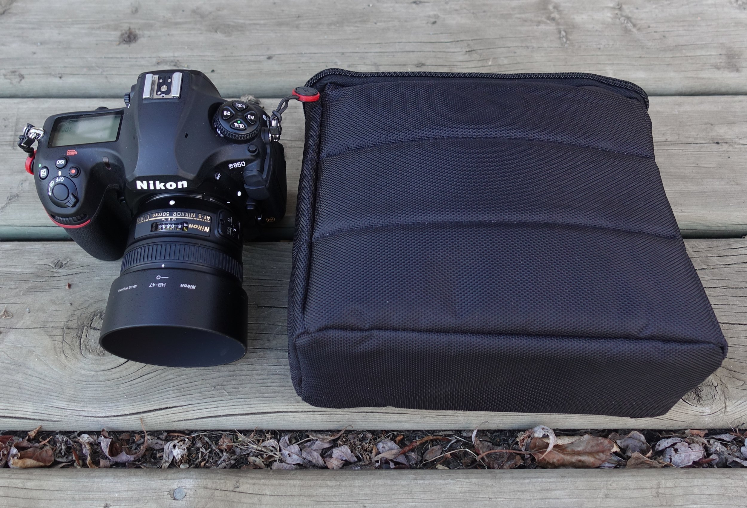 The Chamonix in its case, next to my DSLR for size