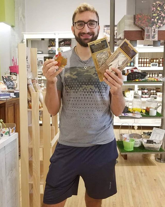 Another happy Fruit of the Land customer!  Agus, visiting from Texas with our best seller Canadian maple syrup and chocolate! #SuitcaseFriendly 💼 __ Visit us in store for the best Canadian gifts and souvenirs to take to friends abroad!🇨🇦 __ Stores at: @promenadesc @vaughan_mills @shop_hillcrest @bvshops