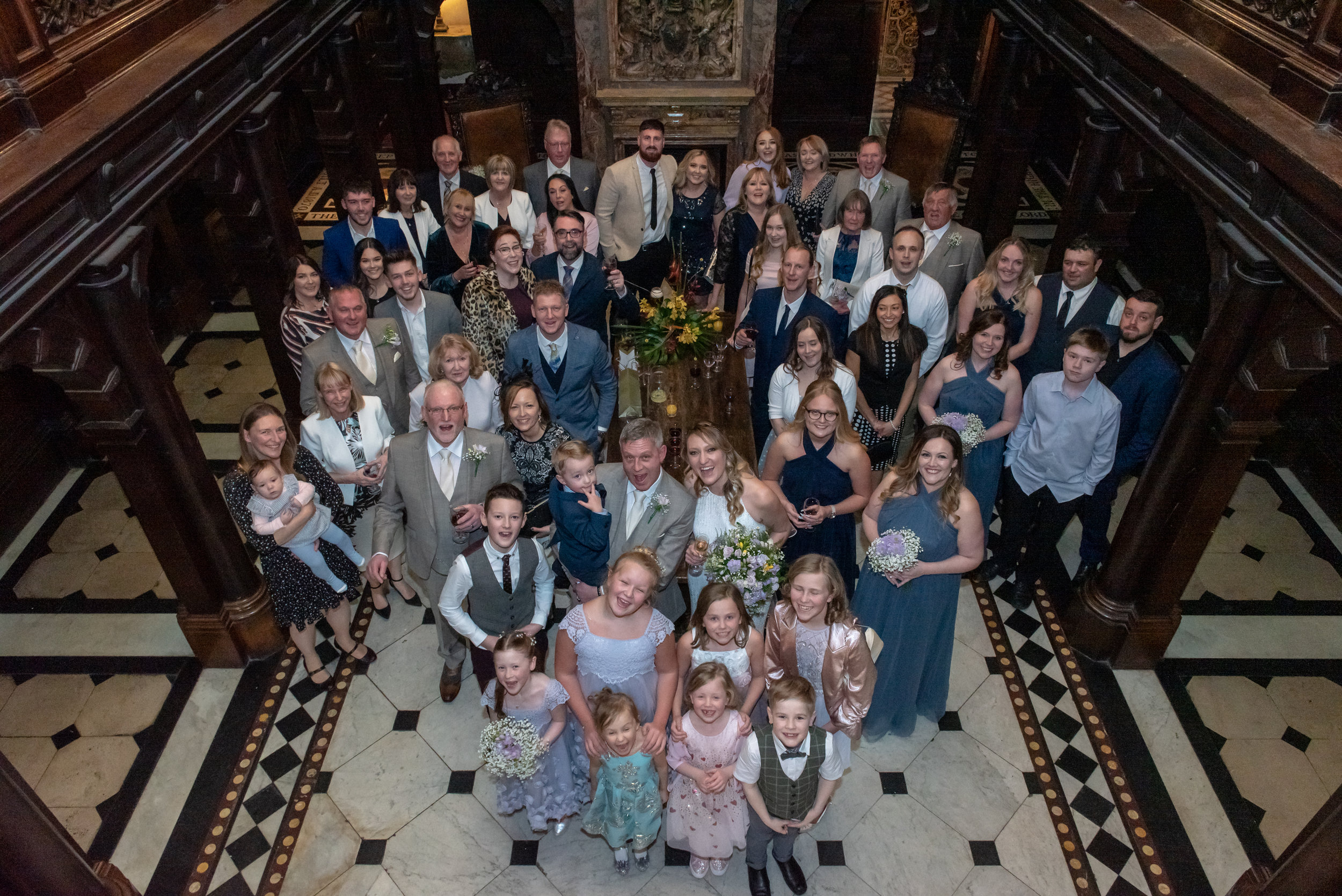 Wedding group photos indoors at Crewe Hall