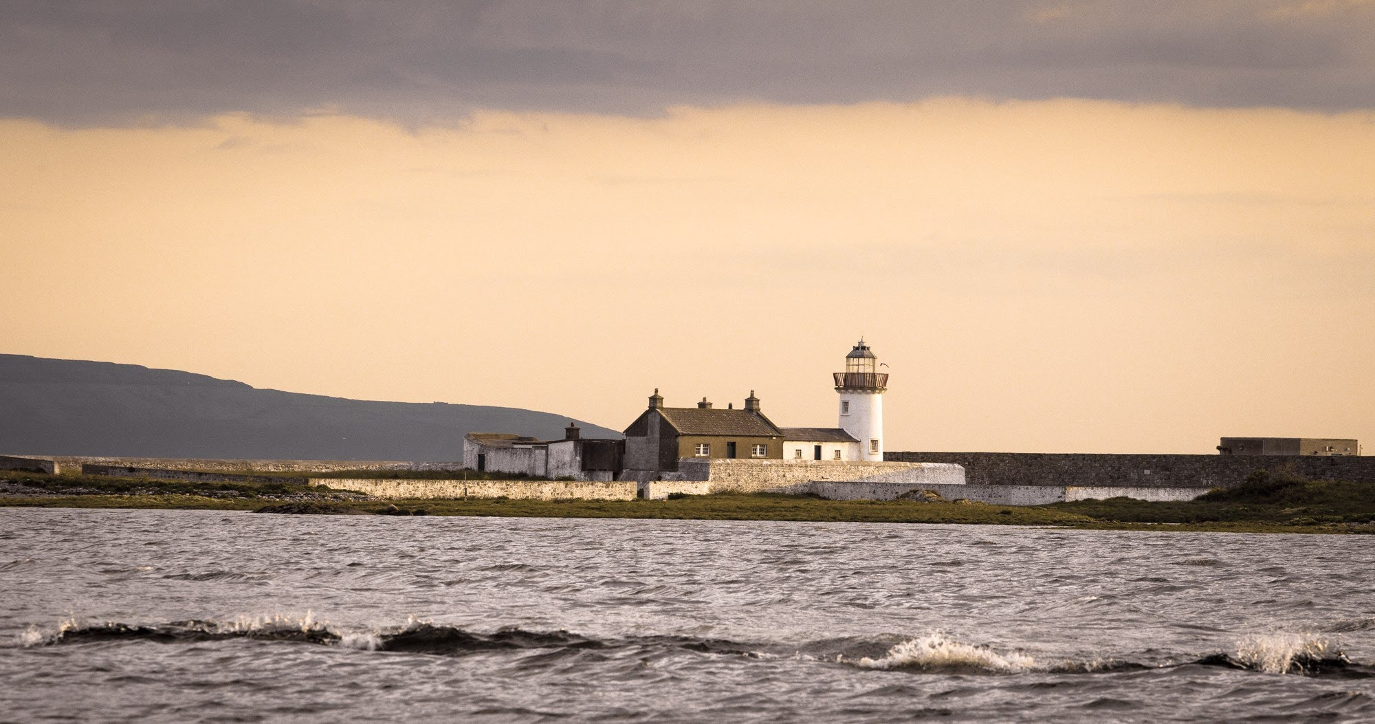 Mutton Island Light House & Keepers Cottage, dating back to 1817.  Home of countless seals & sea-life.