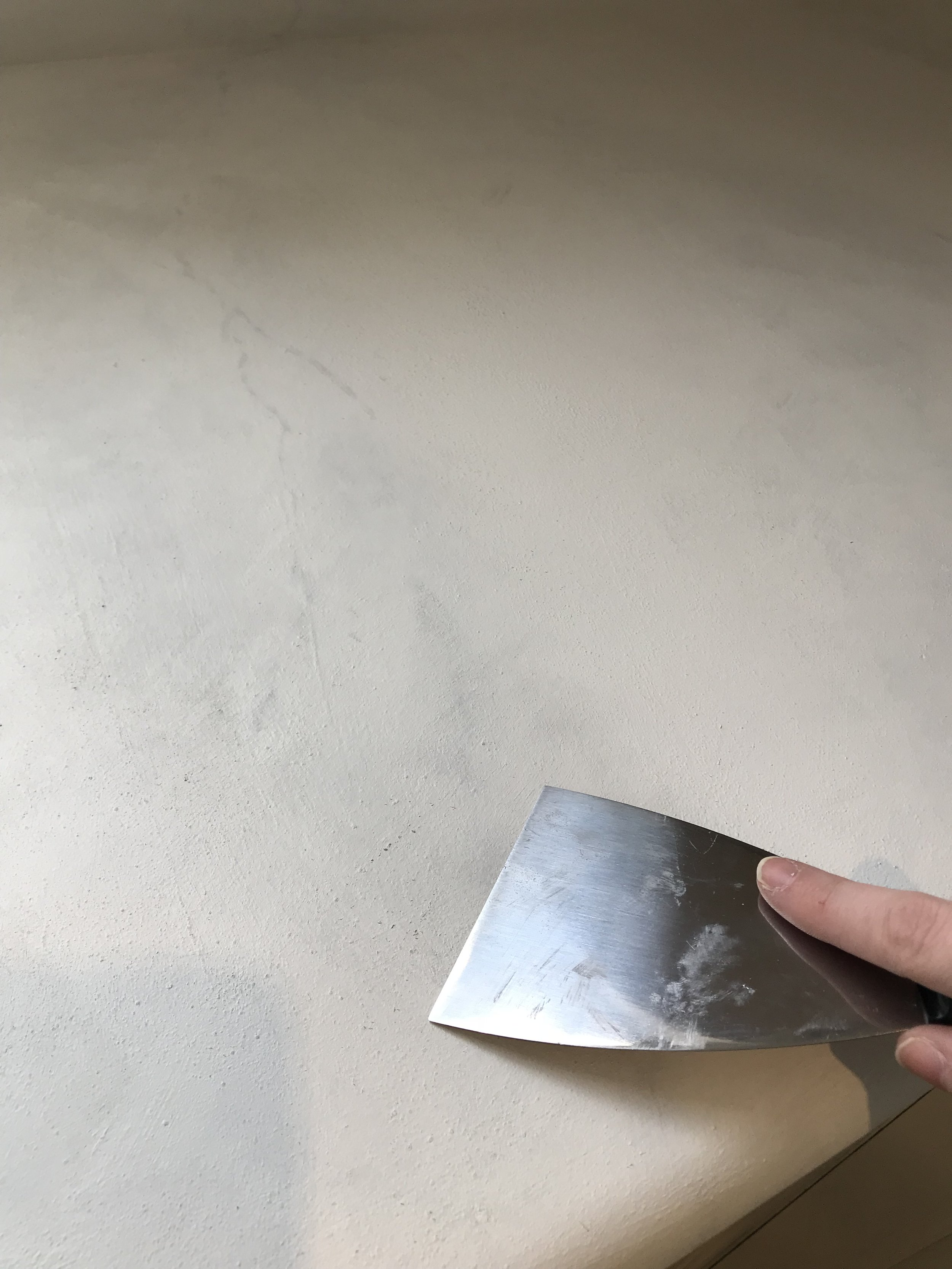 Scraping away any bumps and texture