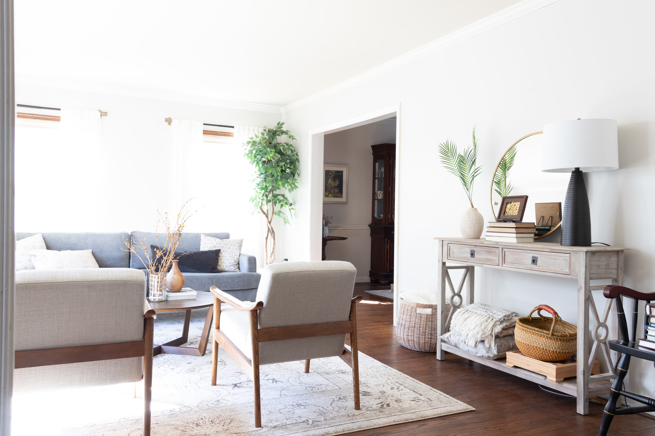 From Boring & Brown to Modern & Cozy - Amazing before / after of my parent's living room. Check out how I was able to stay true to my design aesthetic while also giving my parent's a room they love.