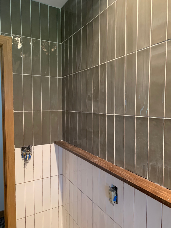 Bre Purposed - Bre has been working on her half bathroom, and I was so excited to learn that you can put new tile over older tile!! Did you all know that?! And the tile she chose is absolutely amazing- her design is really coming together beautifully!