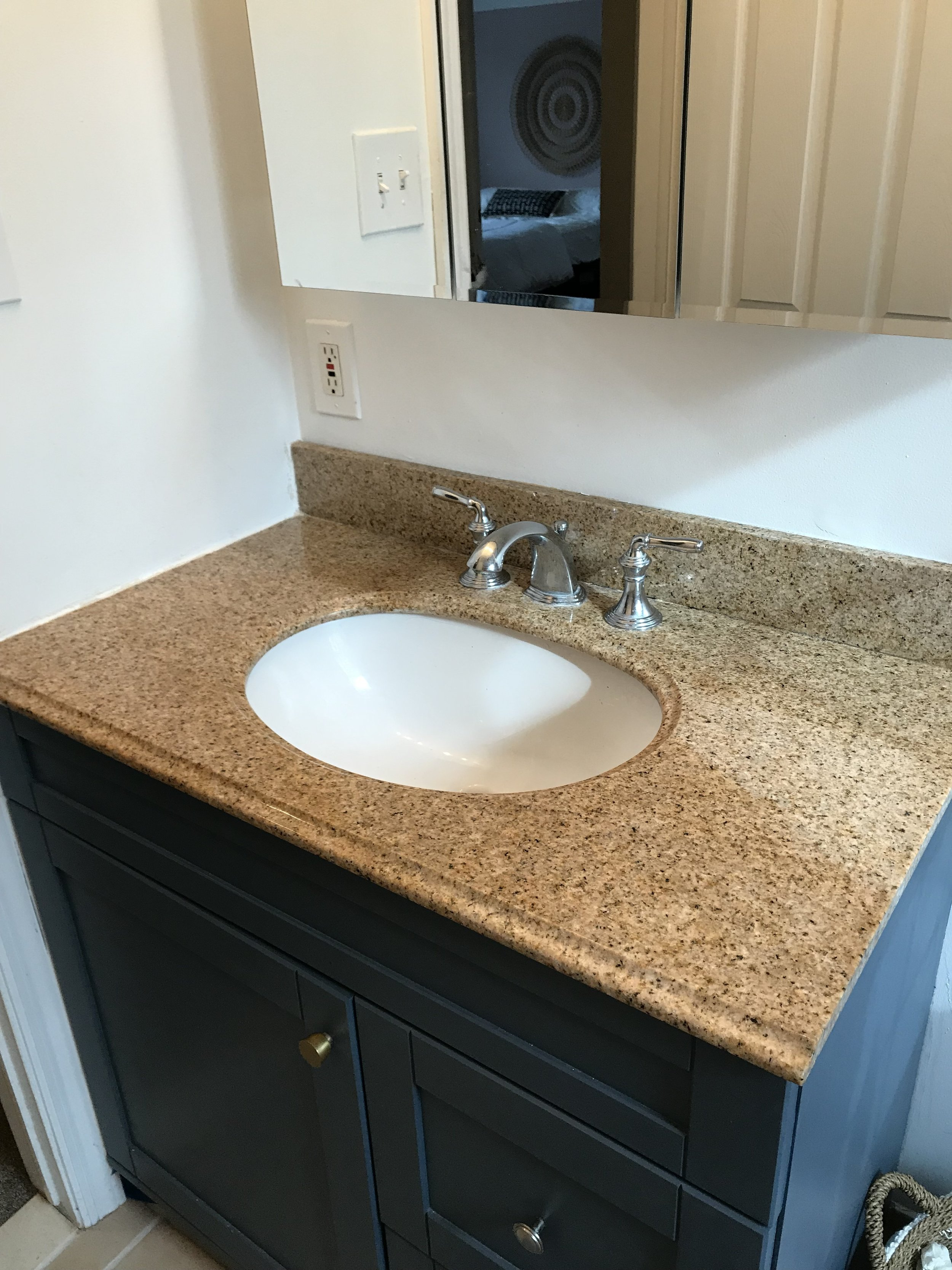 The counter top wasn't  bad…  but it clashed with the floor tile and shower tile