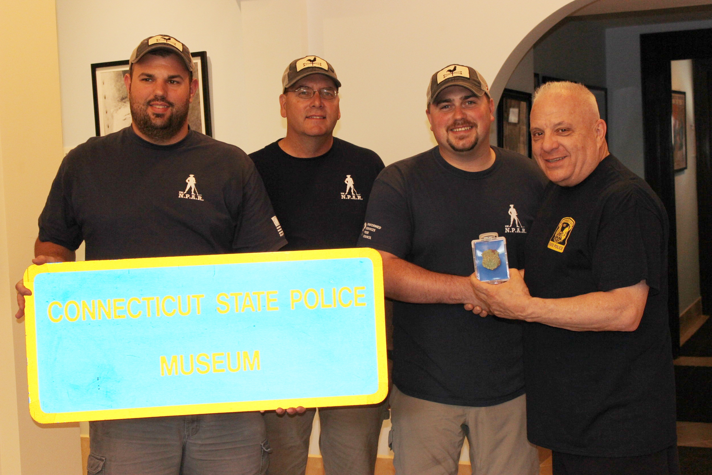 mission accomplished ! - June 30th 2018, Team N.P.A.R. was fortunate enough to get our first piece of recovered History into the Connecticut State Police Museum. It was a Honor meeting Jerry Longo a retired Connecticut State Trooper, and Director of the Museum. Being First Responders saving Emergency Service History is important to us. This was a big goal of ours and I can't thank Mr. Longo and my Team enough for this accomplishment. (Jerry Longo seen on the right of photo receiving the badge) (Deputy Warden Badge seen in photo above)