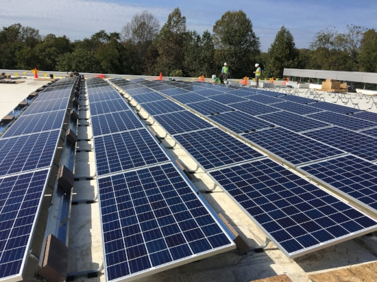 """Installation of solar panels — a """"big win"""" for energy efficiency — on the City's Smith Aquatic & Fitness Center."""