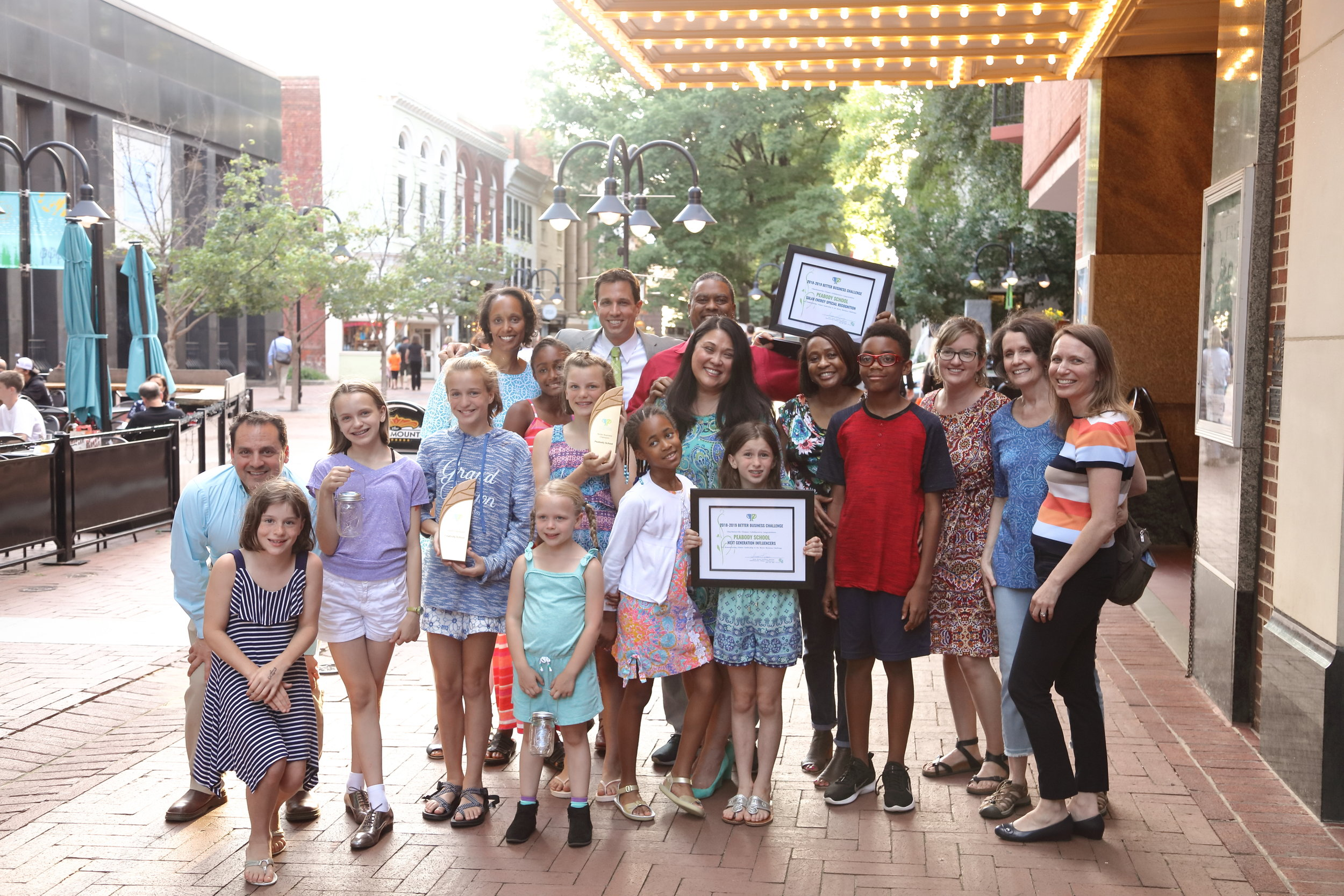 Peabody School outside Paramount with Award.JPG