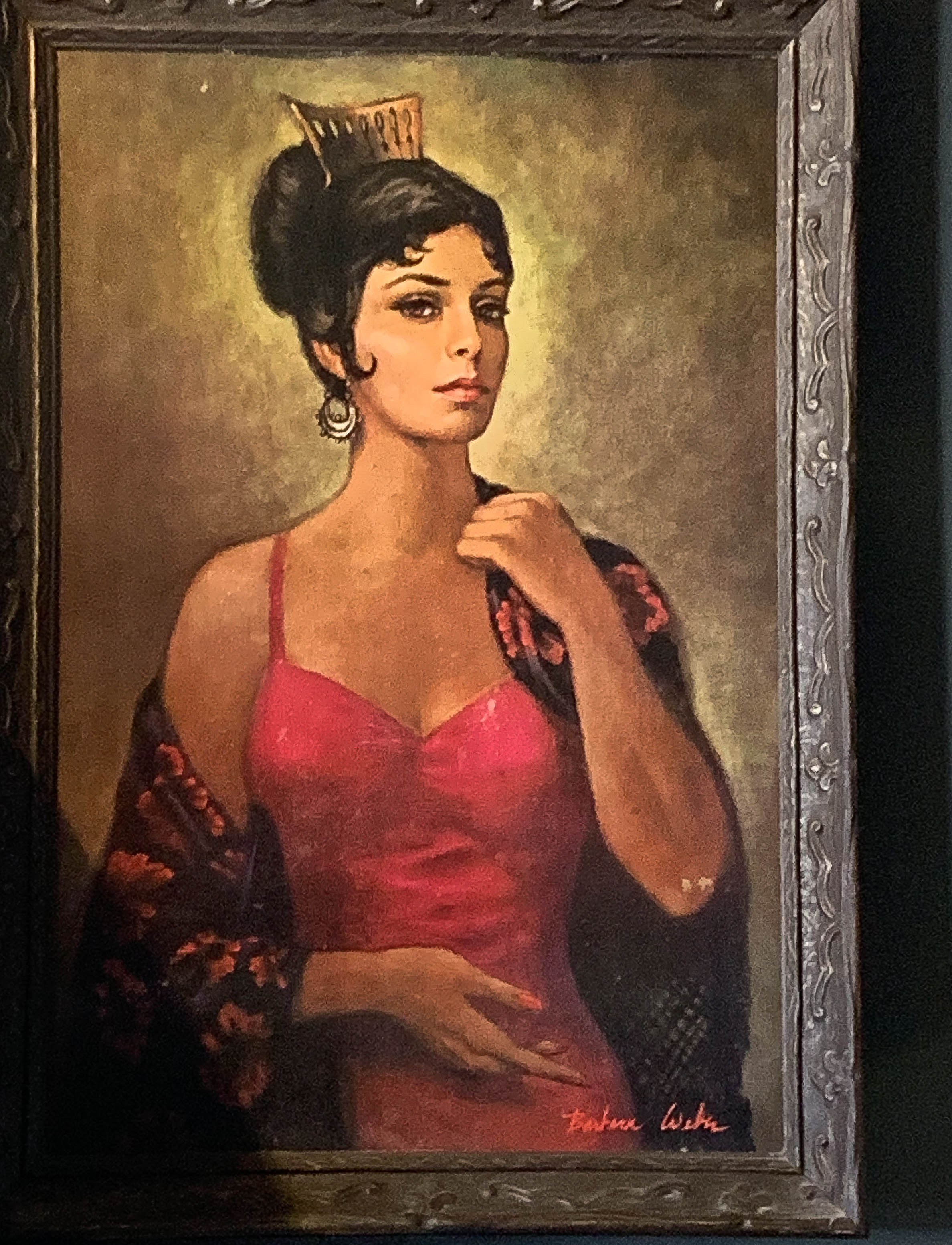 The lady of mystery hangs in Comet Cafe. No one seems to know who she is.