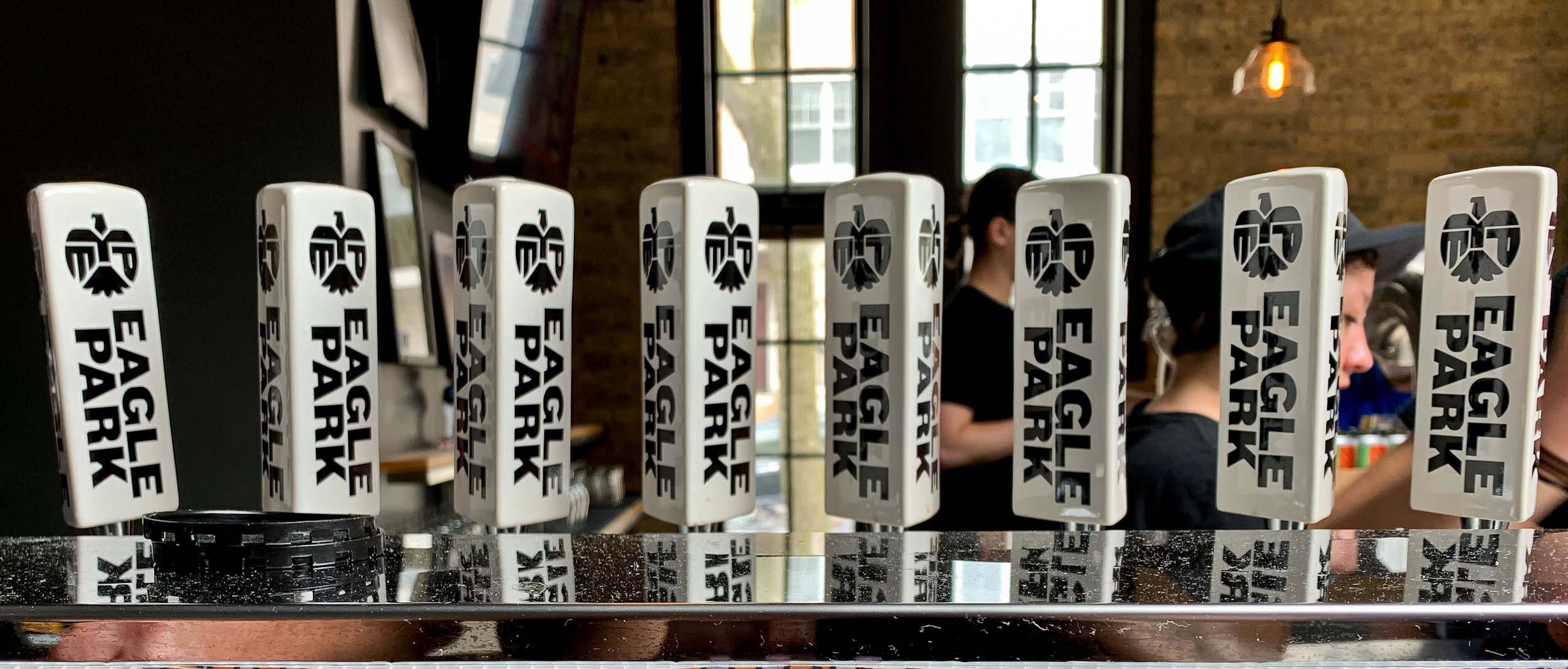 Tap handles at Eagle Park Brewing. Their patio action is a very solid option.