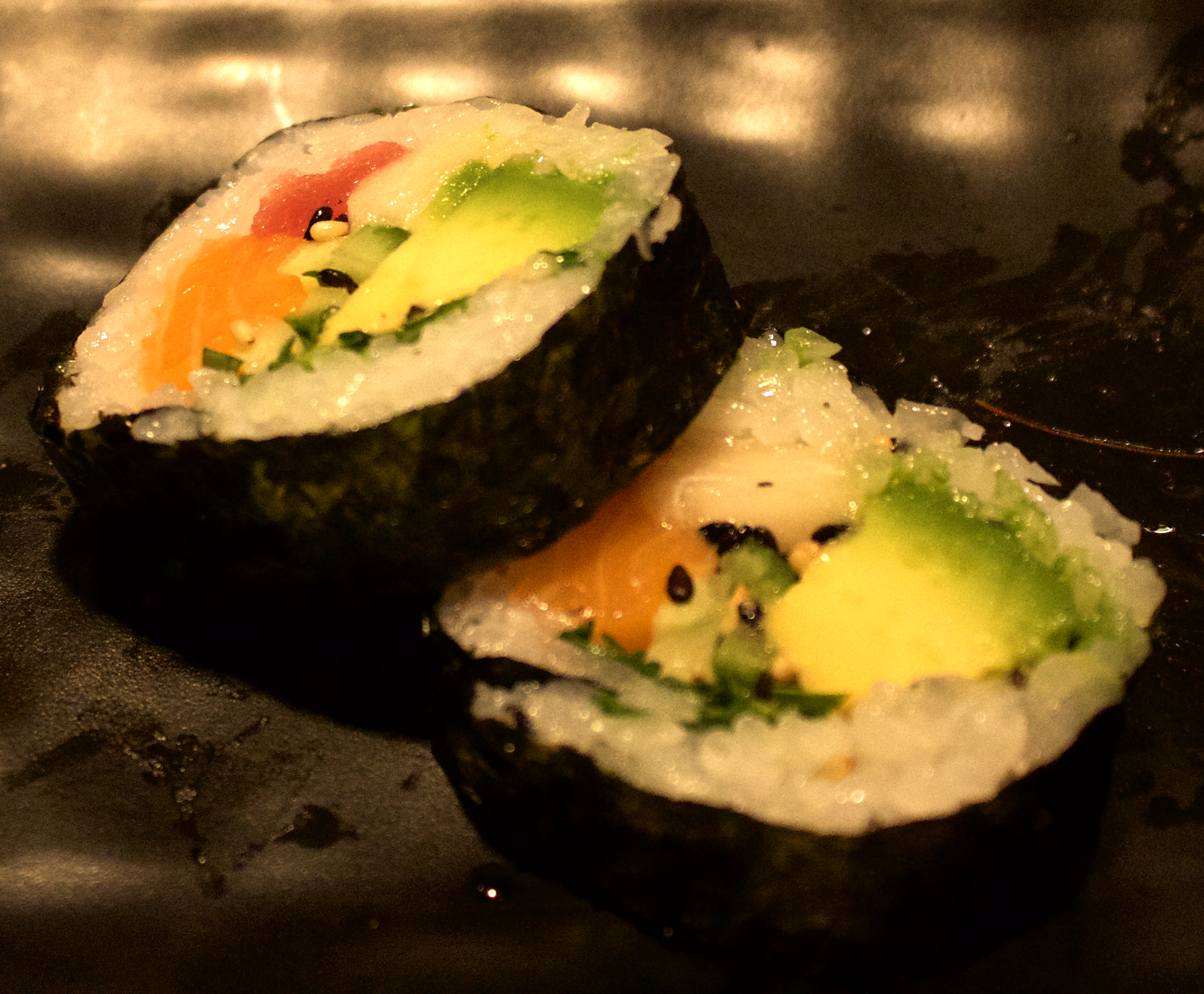 There's three different types of fish stuffed into this roll.