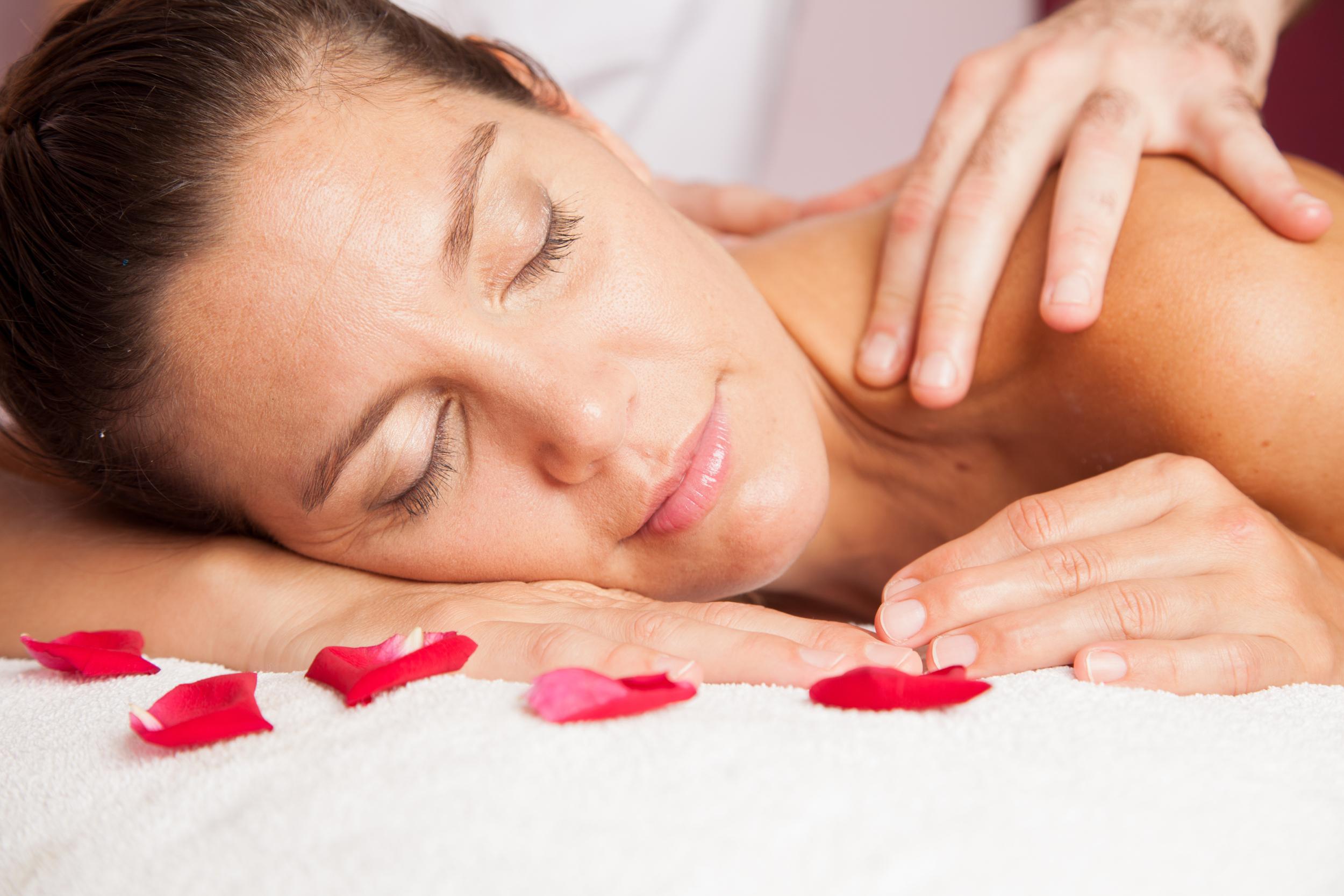 woman-receibing-a-massage-at-the-spa_rwuxG2hv2Me.jpg