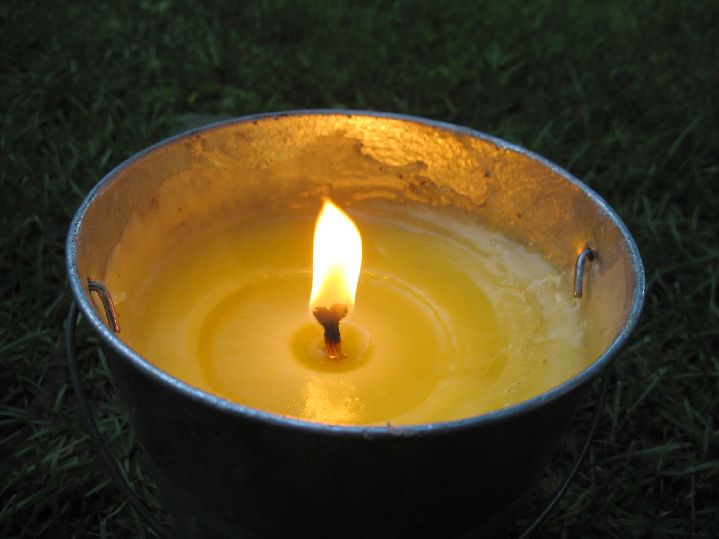a-yellow-citronella-bucket-candle-perfect-for-those-summertime-evenings-to-keep-the-mosquitos-away_BKnxRgKCHs.jpg