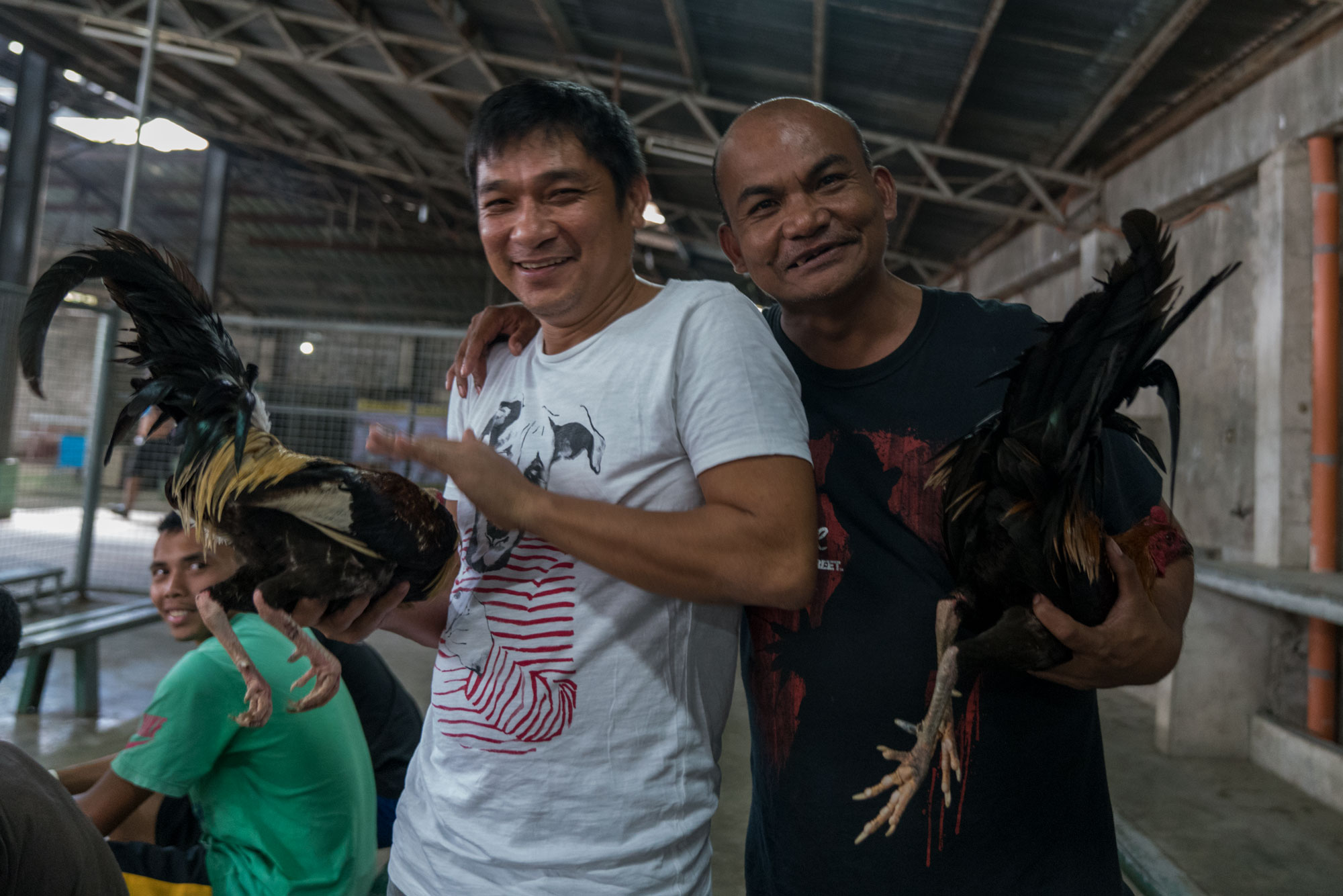 Owners pose with their birds  -Rosario Cockpit Arena, Batangas, Philippines
