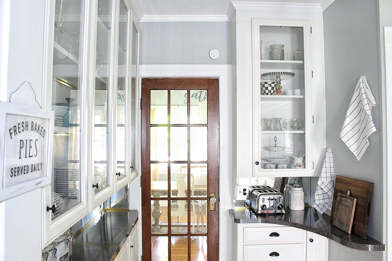 open cabinets in the front of the kitchen