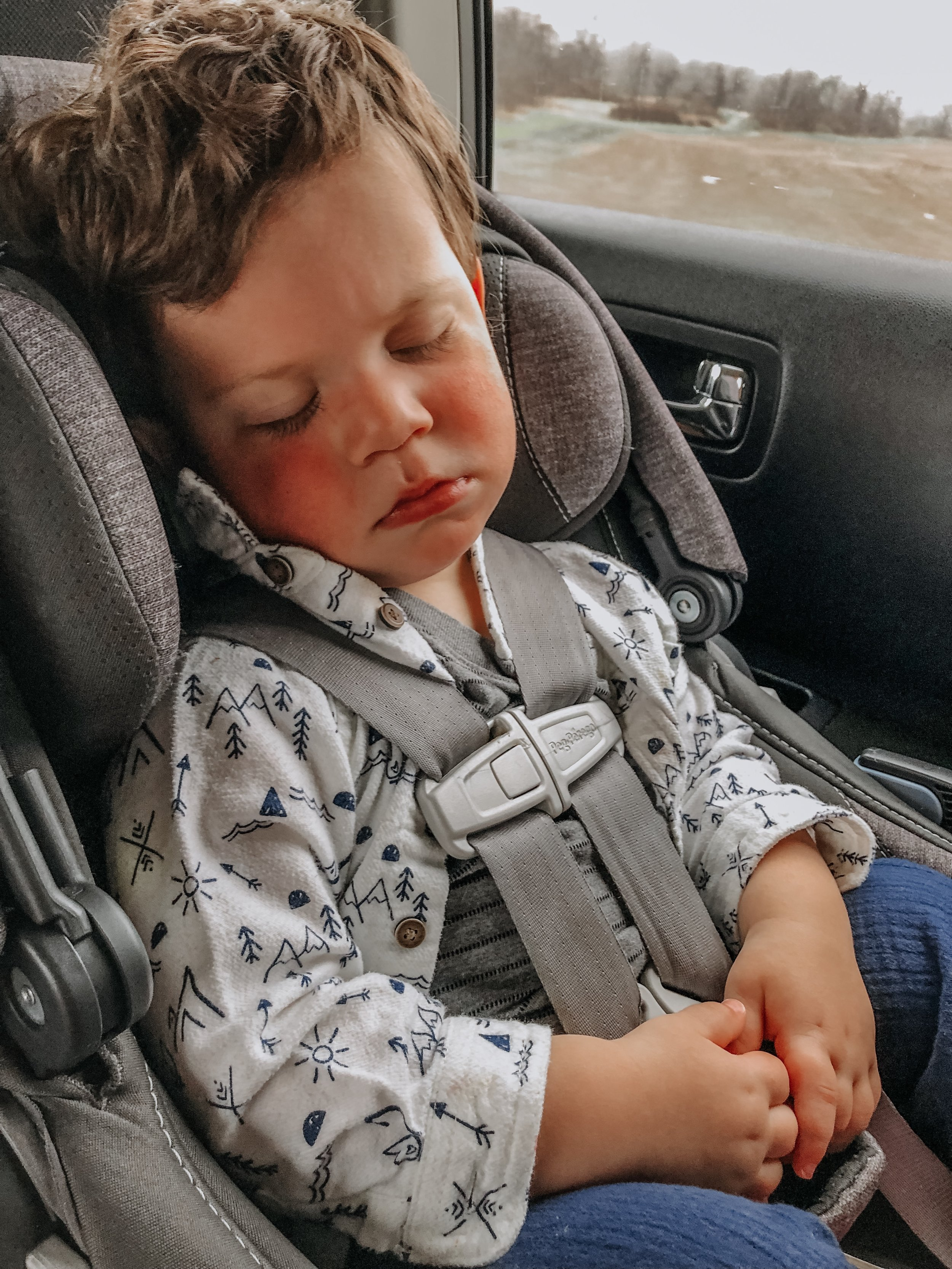 Dominic asleep in the car