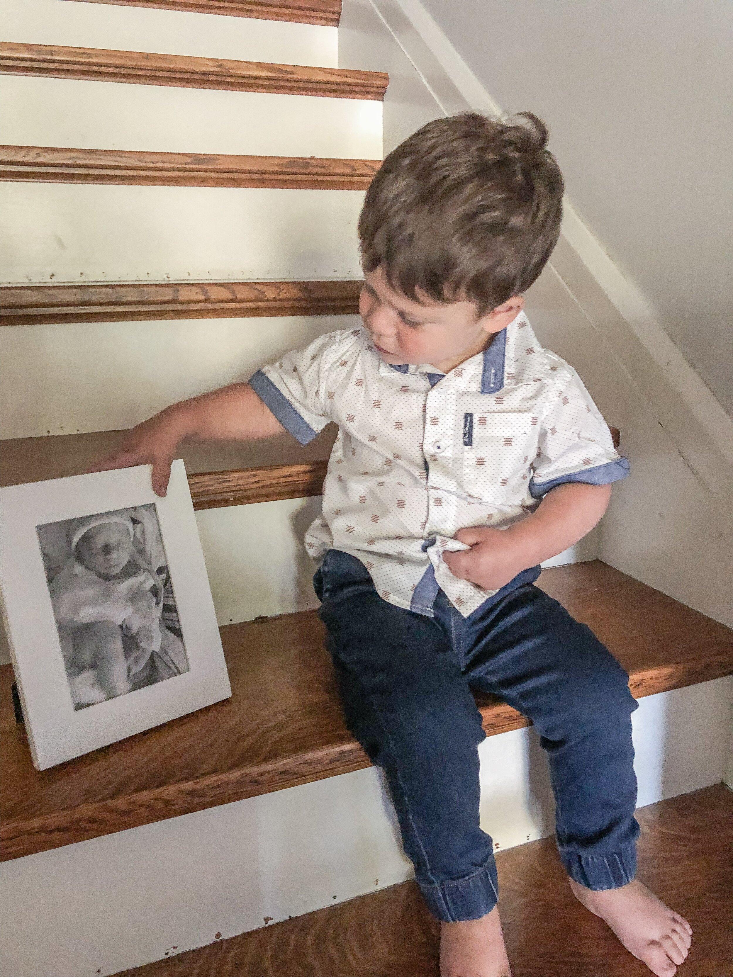 Looking at his newborn photo