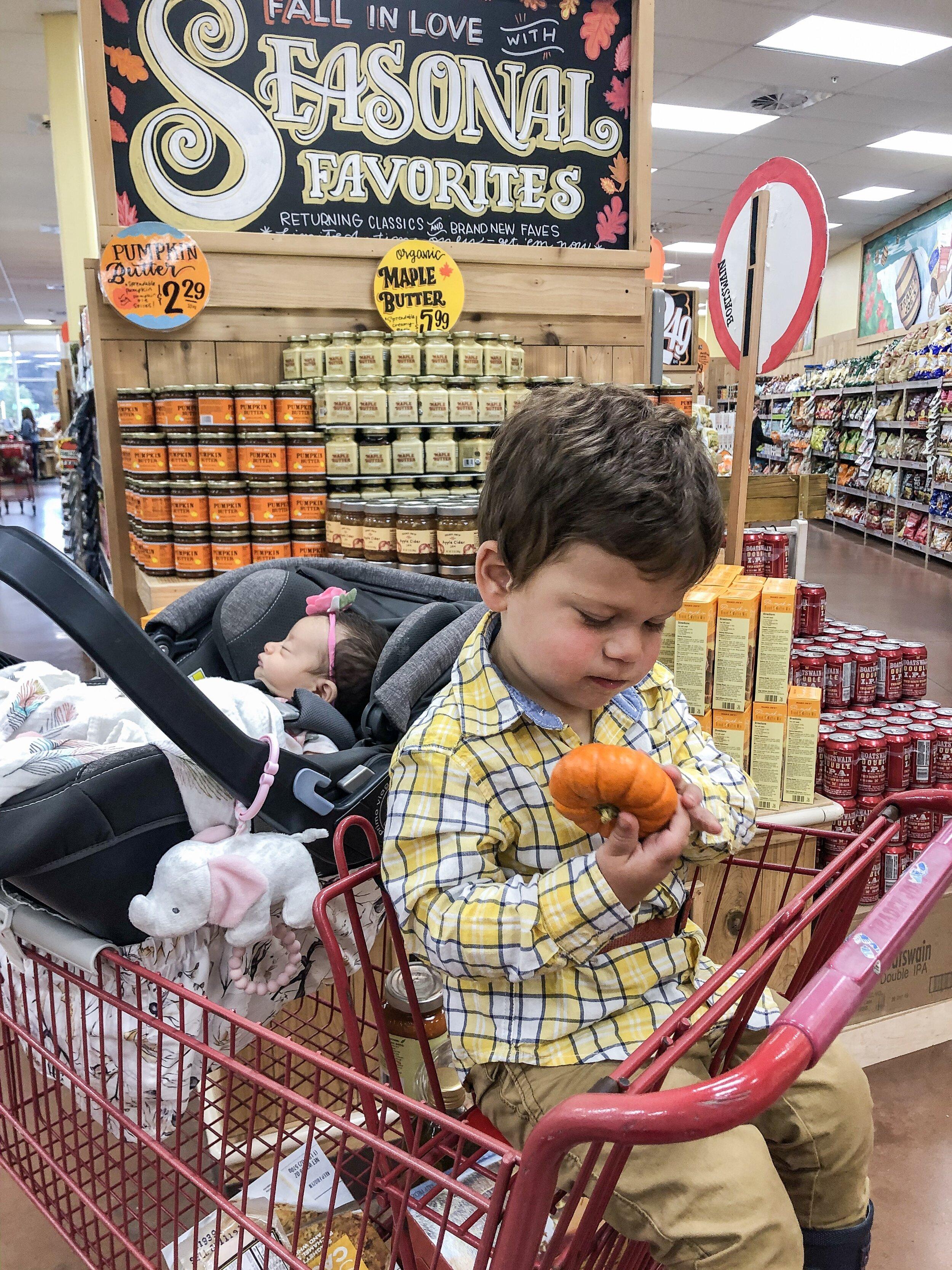 Dominic holding a pumpkin