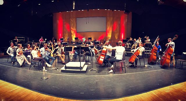 """View of the orchestra setting up before the premiere of """"The Matterlightblooming"""" alongside new works by @annikasoco and Maya Miro-Johnson at Cabrillo. 🎵🎻🎶 . . .  #newmusic #orchestra #orchestralmusic #santacruz #cabrillofestival2019 #cabrillofestival #cabrillofestivalofcontemporarymusic #classicalmusic #music #postclassical #georgesaunders #lincolninthebardo"""