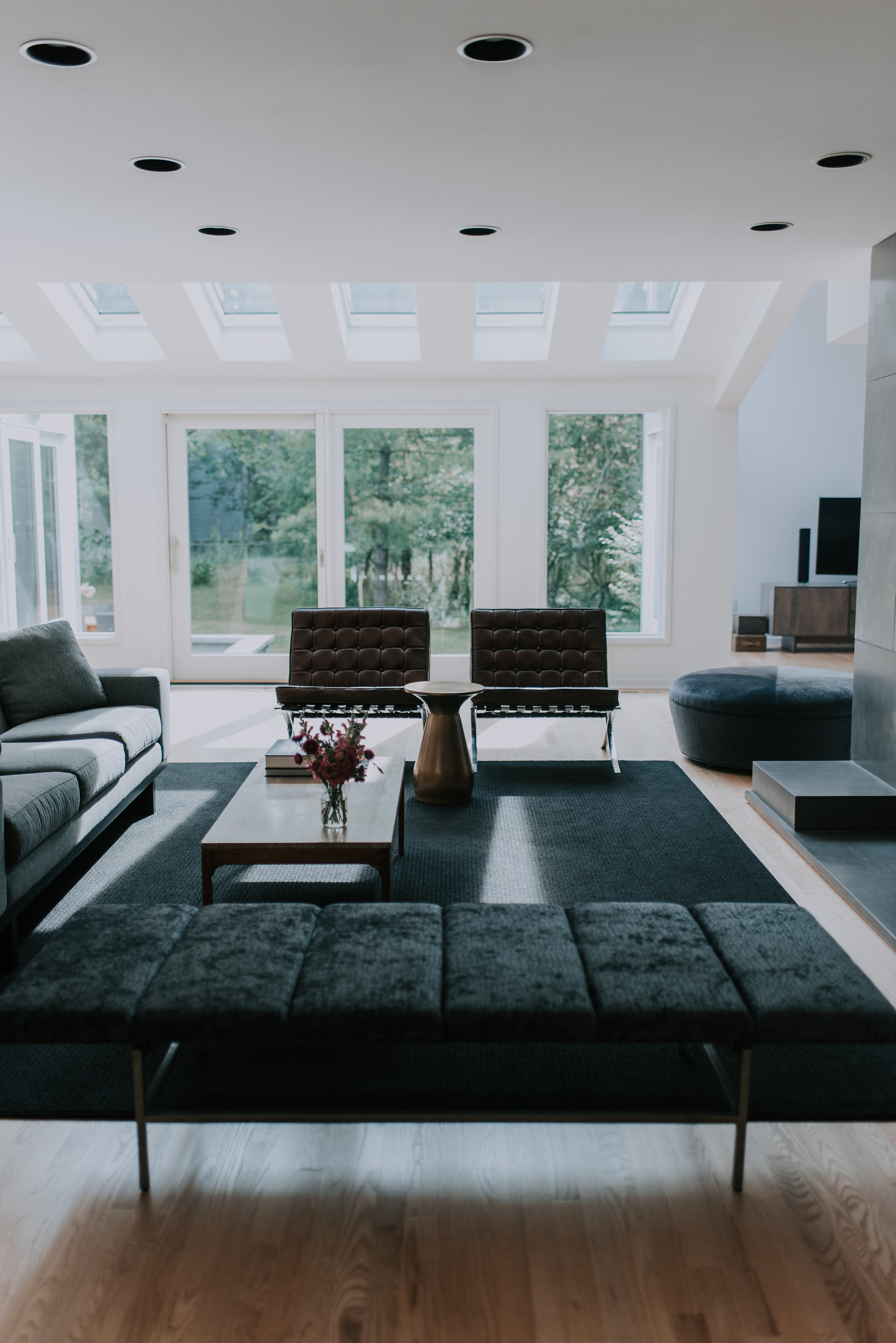 - finding balance Their love for mid-century modern paired well with designer and partner, Linda. The team quickly started a plan to embrace the open layout including living room, dining room and family room.