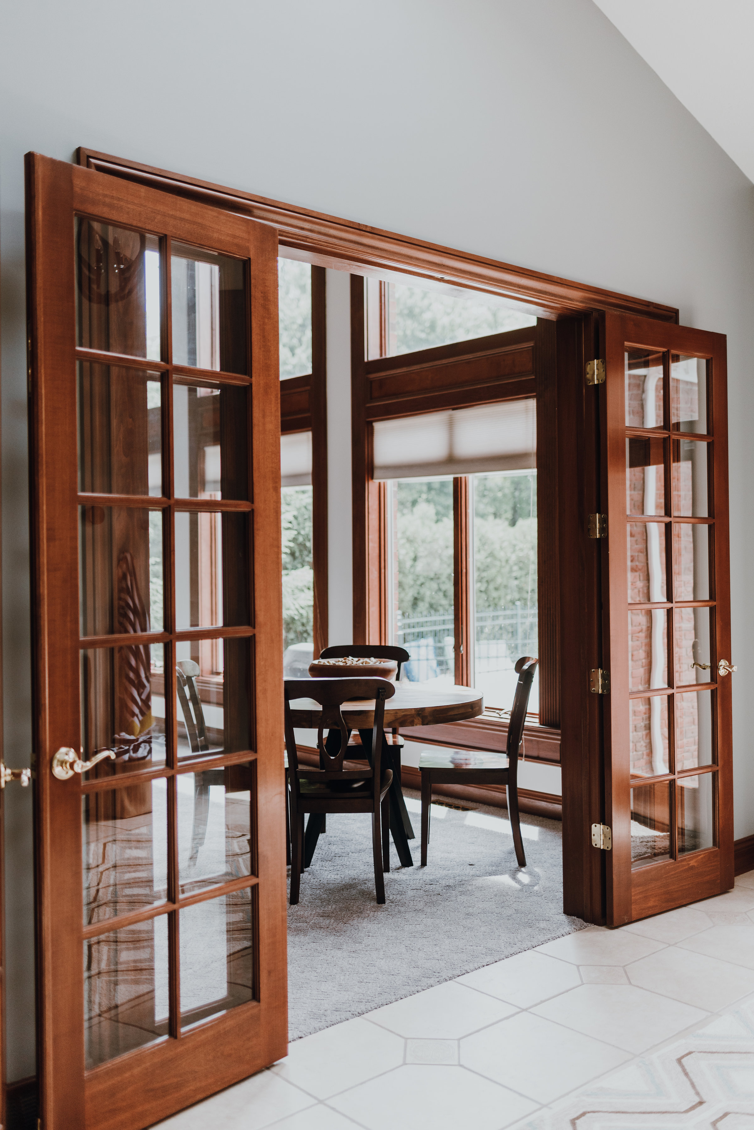 - The estate as it existed included a vast center entrance with grand staircase and heavy, opulent light fixtures. Linda believed transitional lighting and muted palette was needed to achieve a more livable and inviting space.
