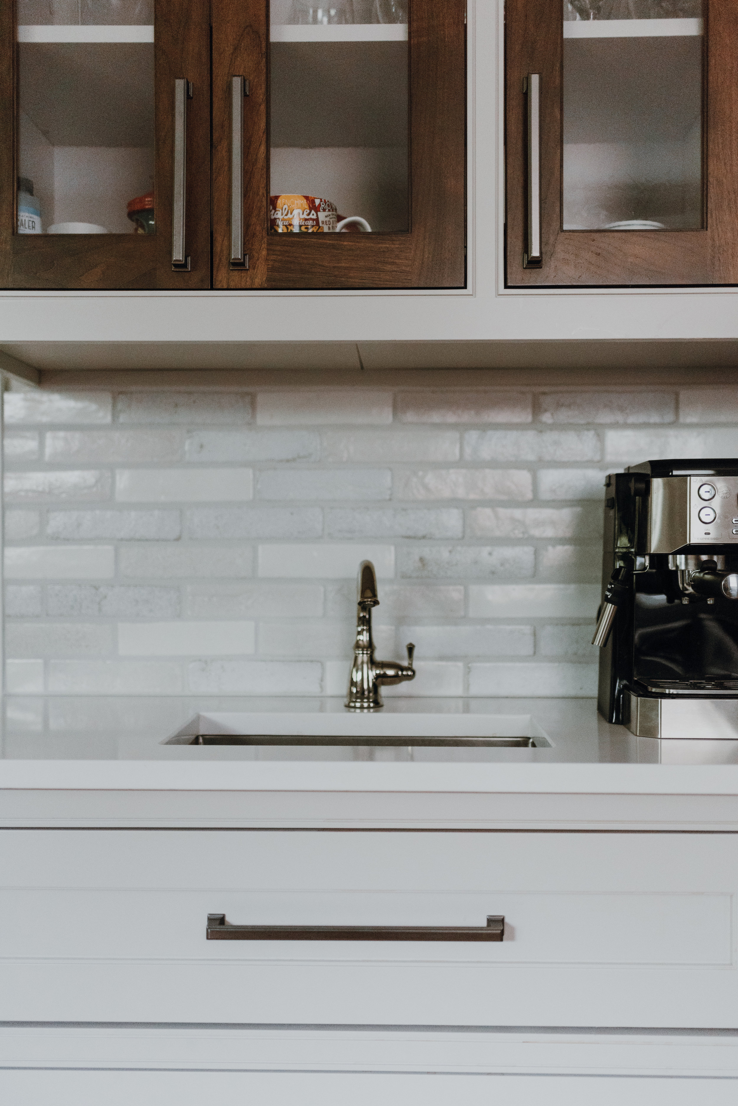 - The space was first structurally reworked lending way for a long run of white cabinets and service area for entertaining.