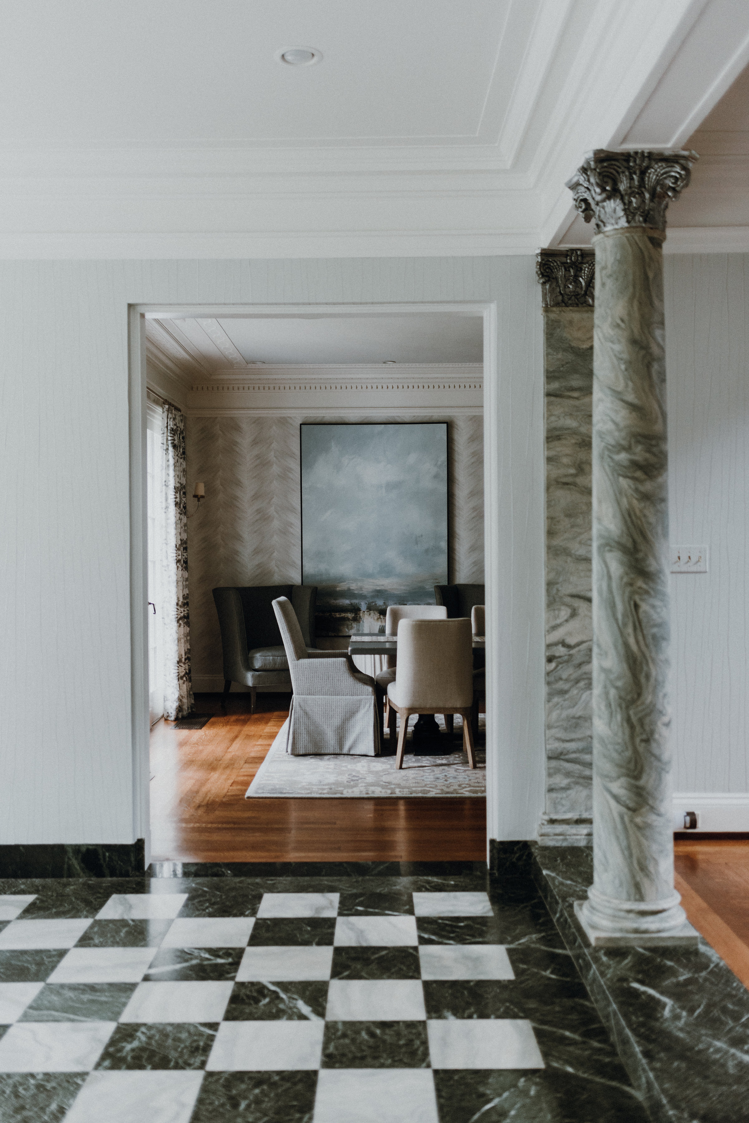 - The estate boasted vaulted ceilings and expansive floors yearning for the perfect furnishings to make it feel like home. Dawn drew inspiration from opulent accents—original marble checkerboard flooring and light-green tinted columns. Dawn opted for a desaturated palette and soft texture to complement the historic materials.