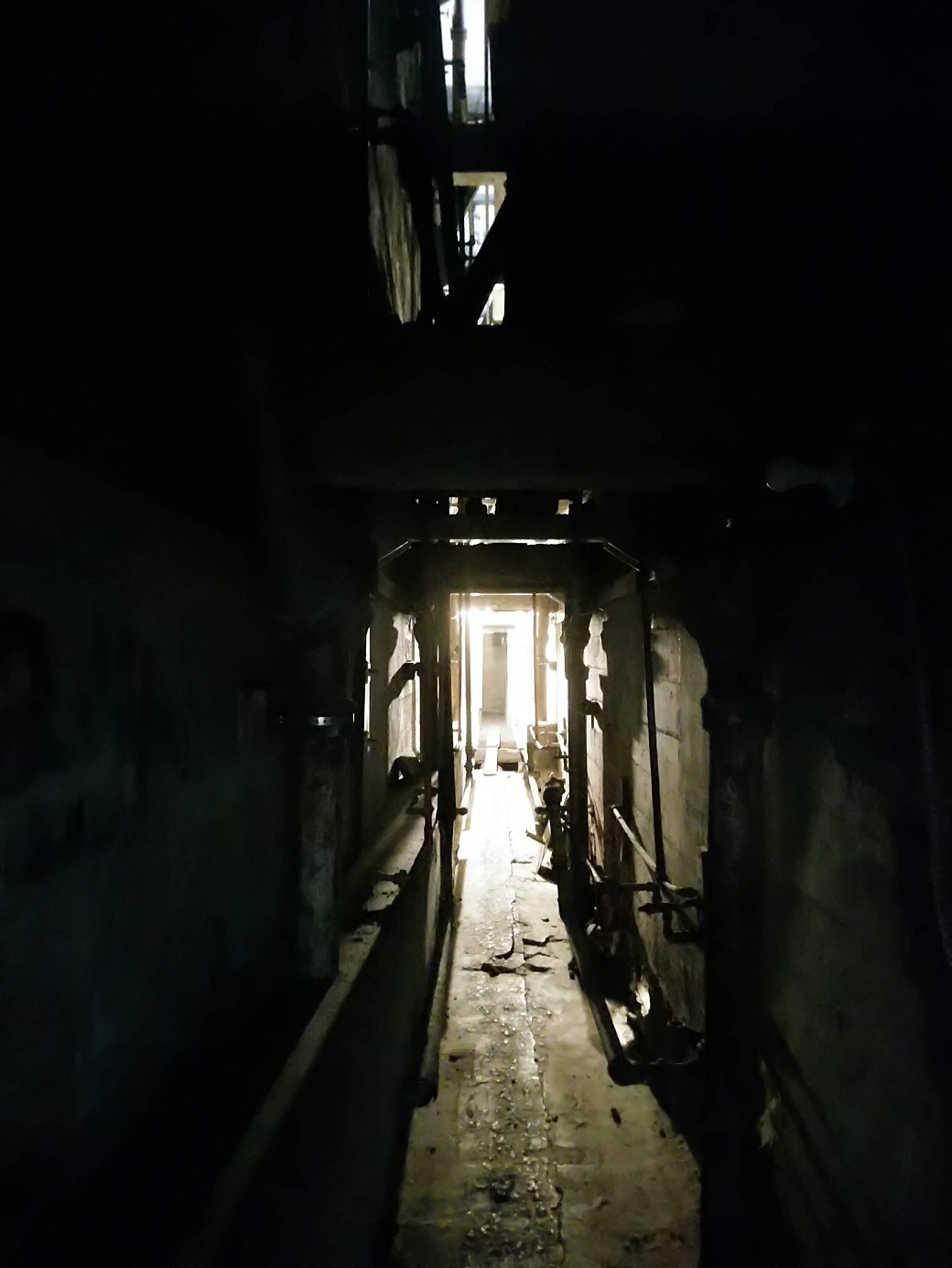 The space between cell blocks. This is how you escape Alcatraz, by tunneling thru the wall and climbing up to the roof.